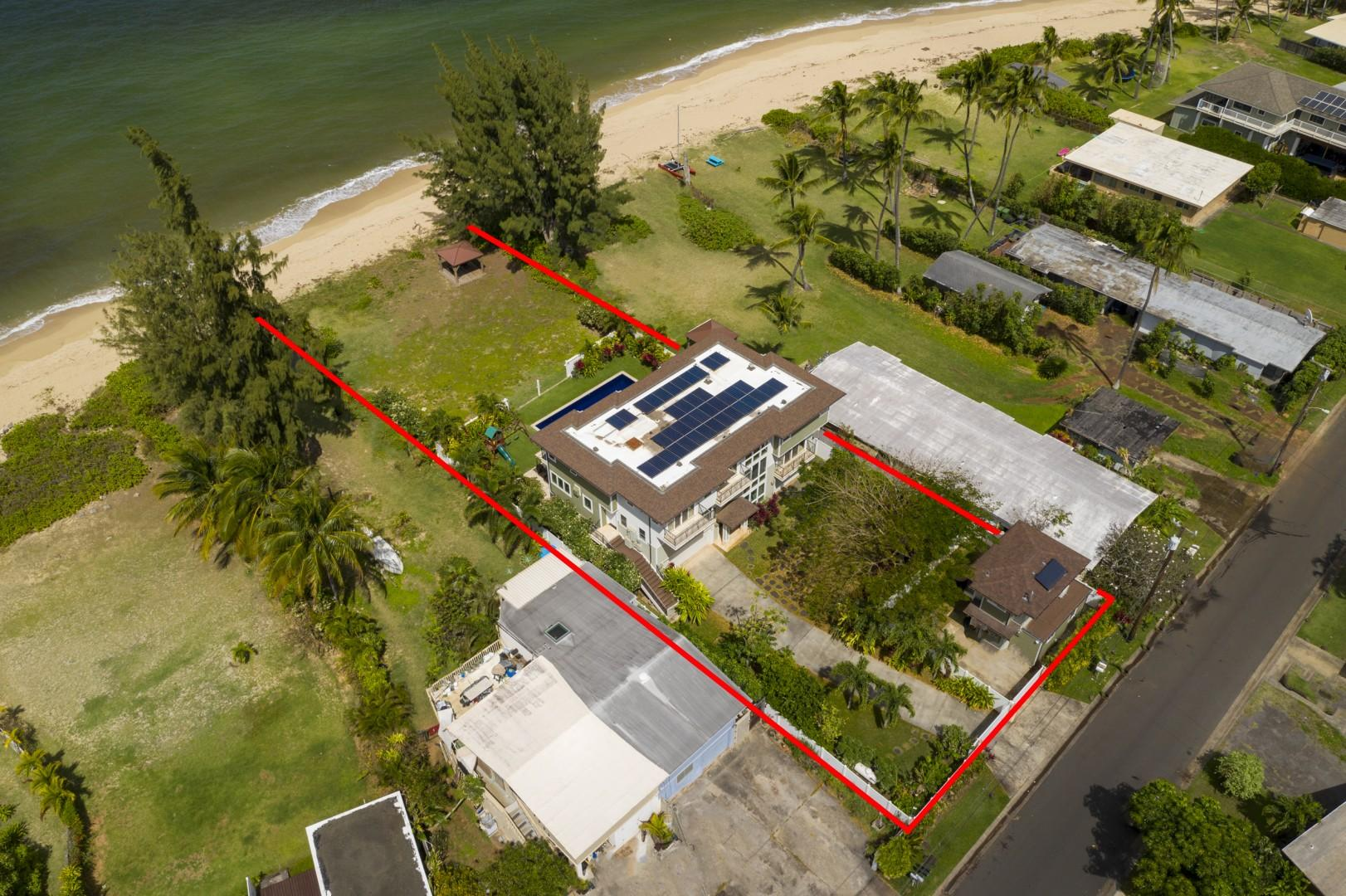 Another aerial view, showing the home's beach access.