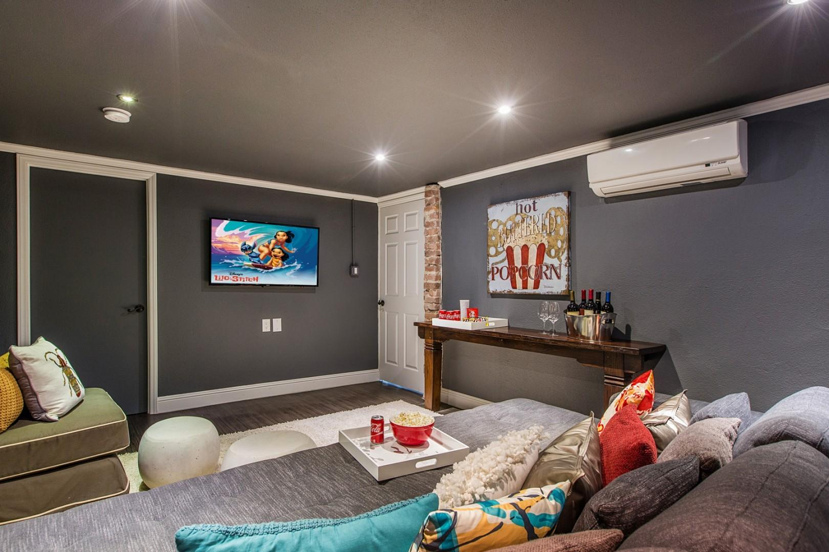 Media room. What better way to end the day than to snuggle up together to watch one of your favorite movies?