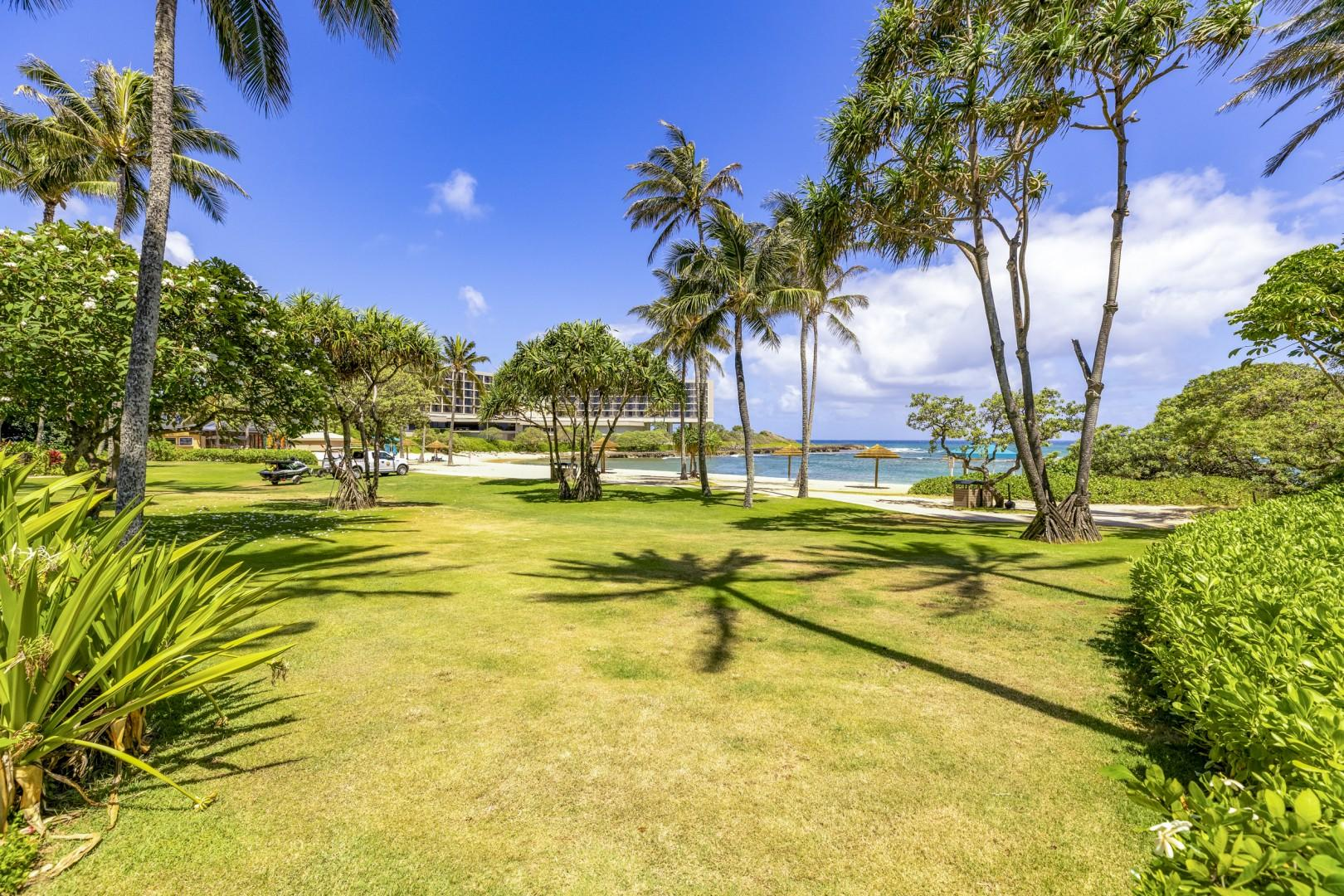 Villa grounds with close access to the beach lagoon in front.