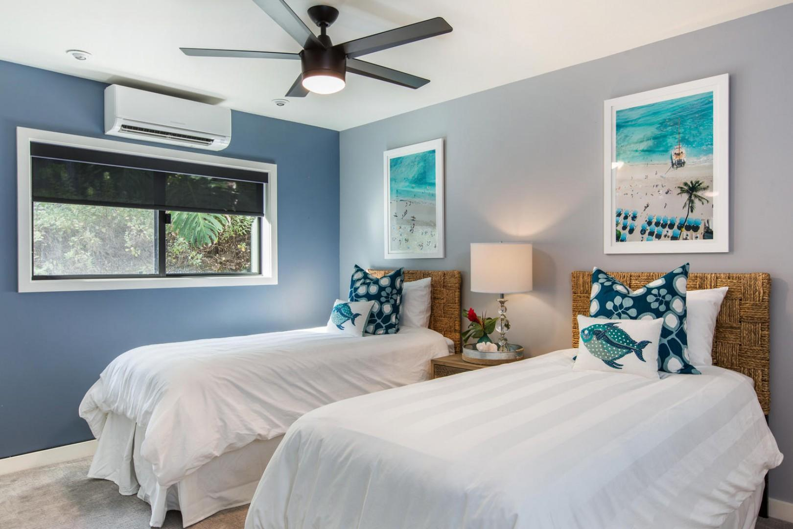 Bedroom four - surf's up! Extra long twin beds are convertible to a king upon request.