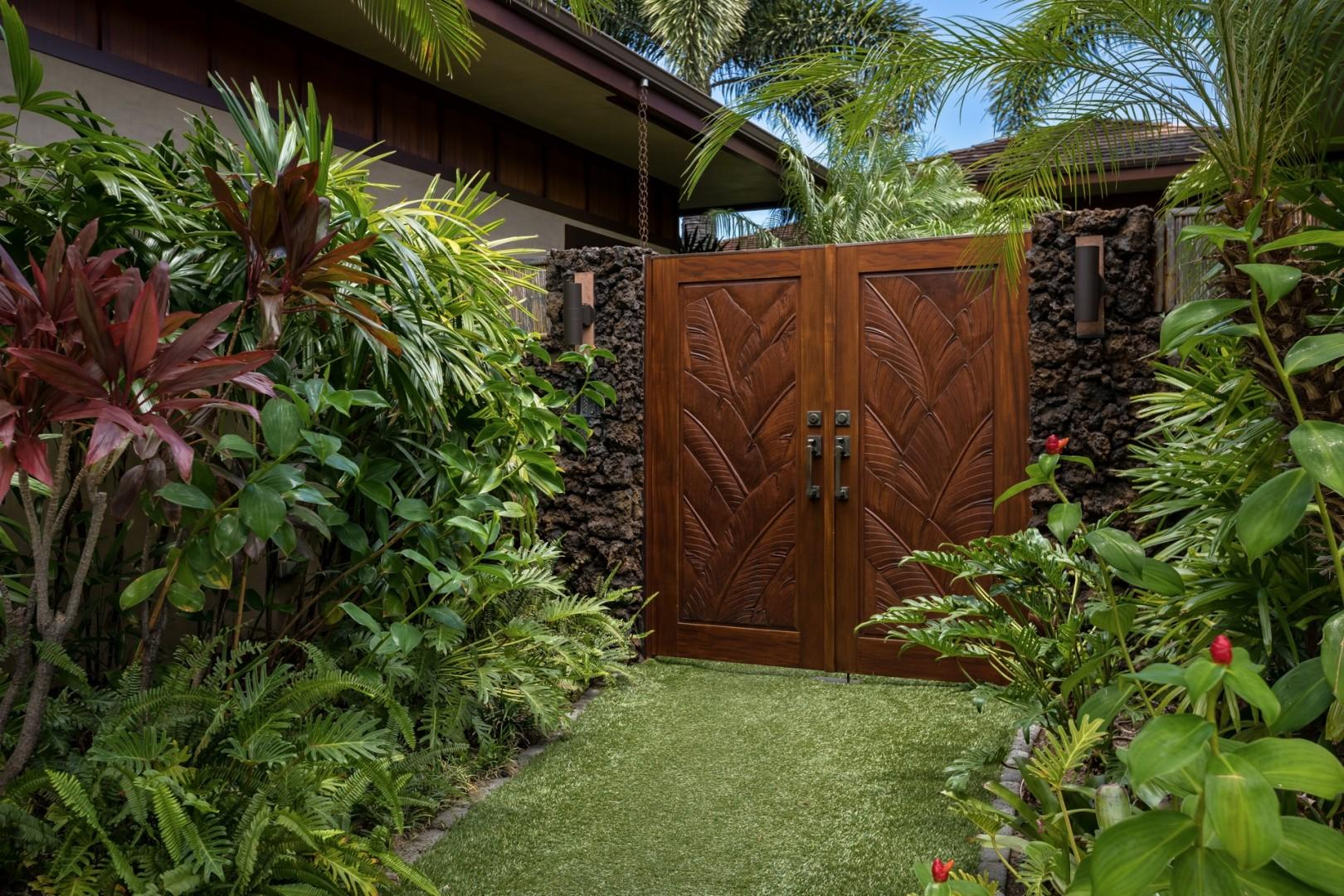 Carved mahogany doors from the motor court to the courtyard home entrance ensure plenty of privacy.