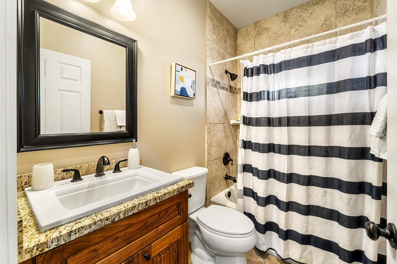 Downstairs guest bathroom with tub/shower combo