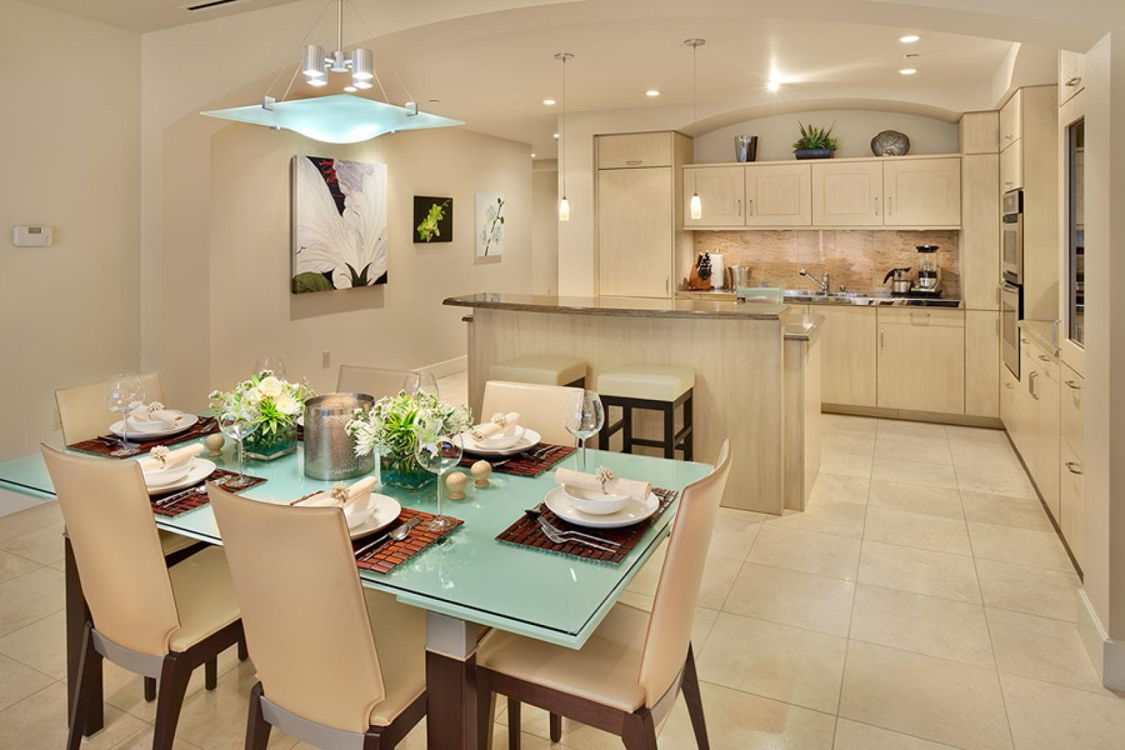 Gourmet kitchen and dining area with imported European cabinetry, granite counters, and an exceptional array of kitchen supplies.