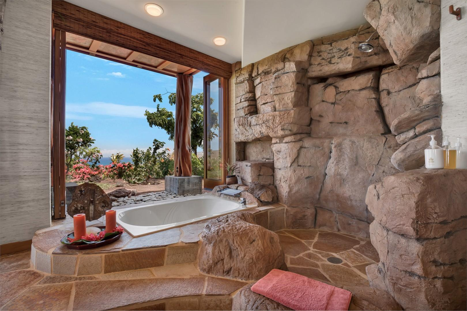 Retreat suite bath with ocean-view soaking tub and walk-in rock shower.