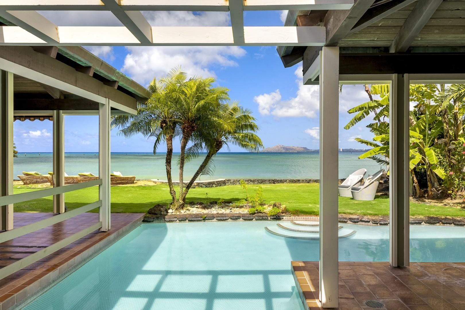 Covered Lanai connecting Master Suite to Main House looking out over pool towards ocean