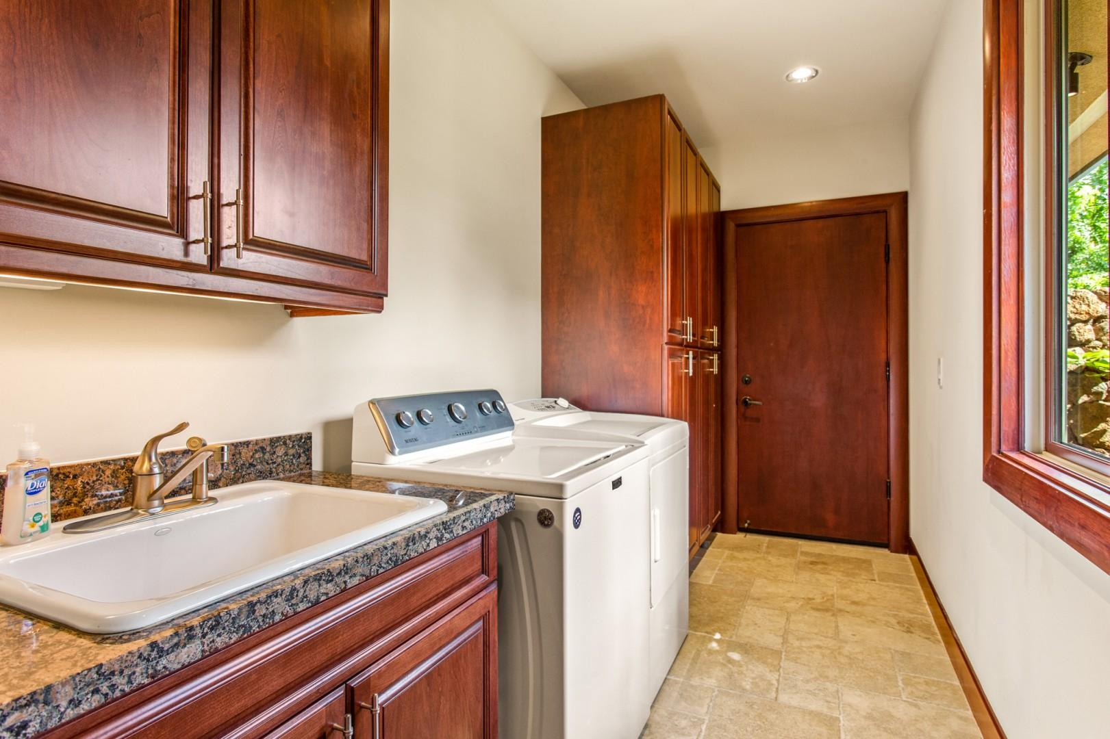 The home's dedicated laundry room with sink, counter prep space, and supplied detergent and dryer sheets provides all you'll need in your home away from home.