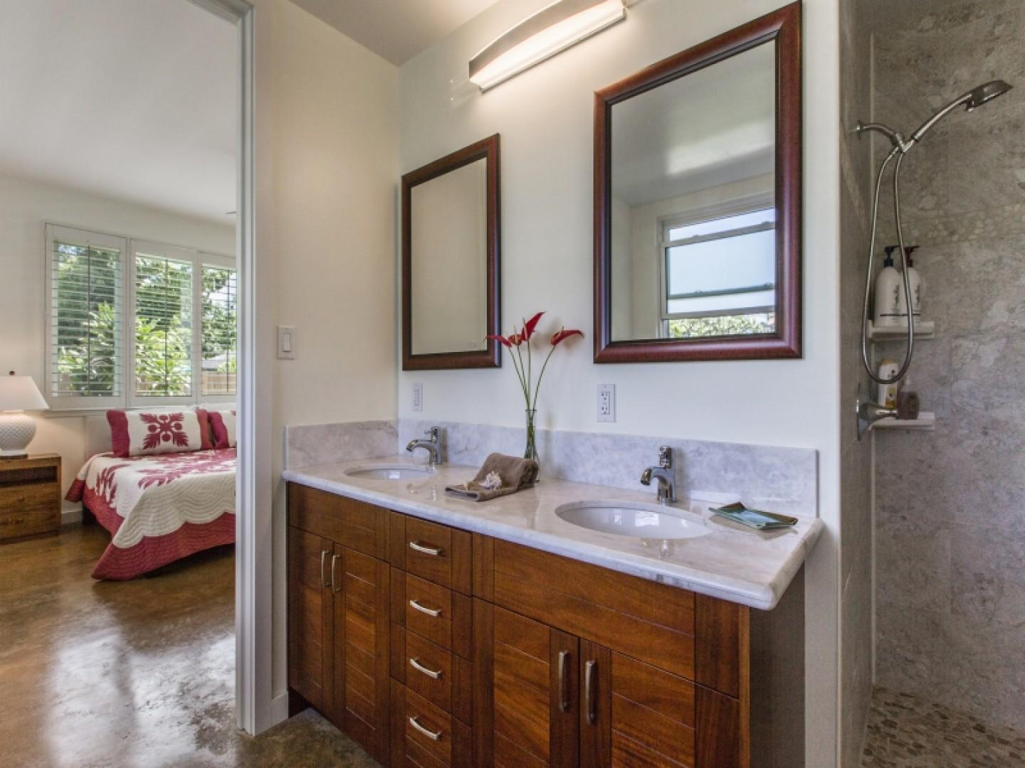 Double sinks and marble counters in first-floor master bath.