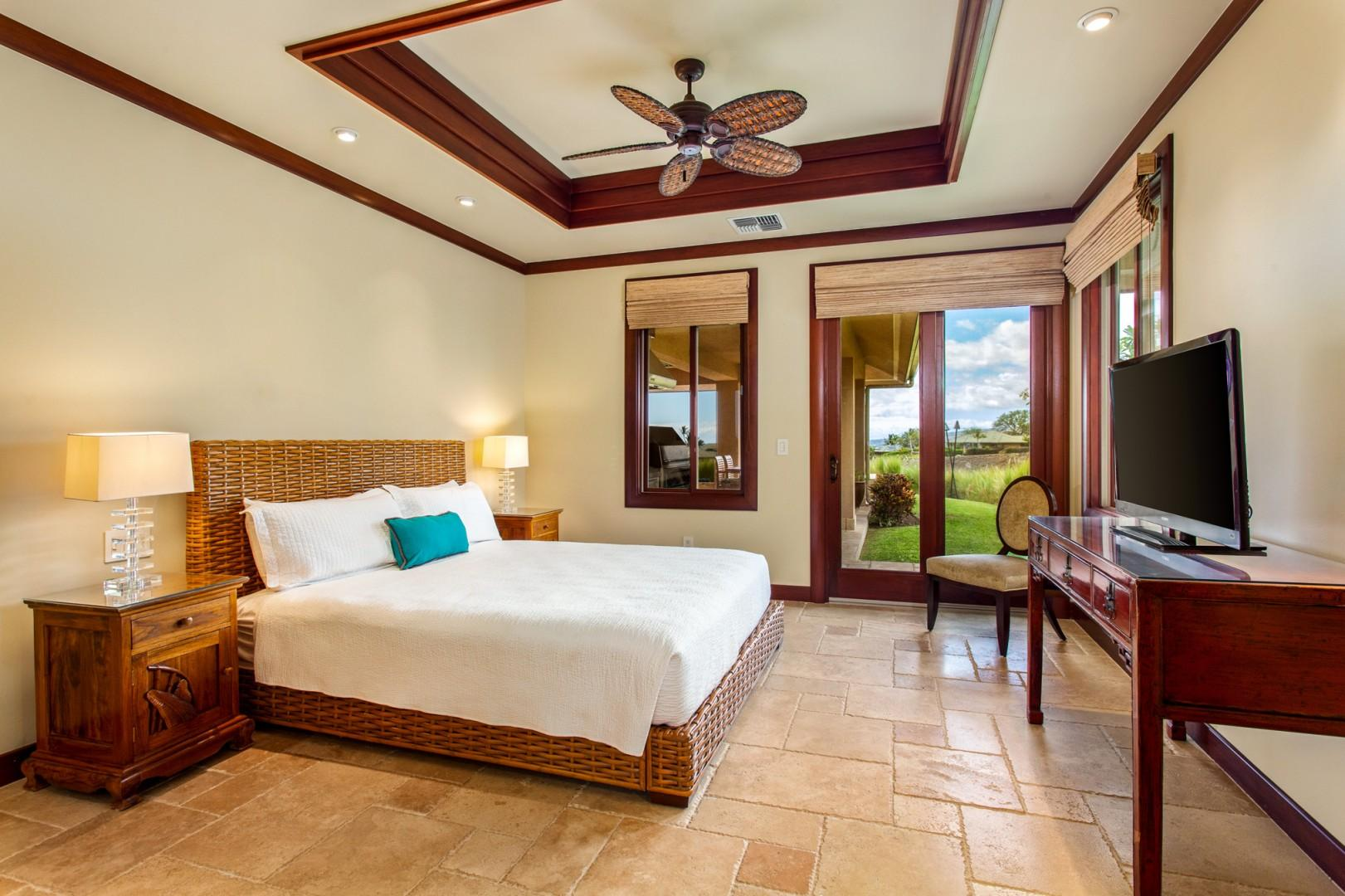 Master bedroom suite #2 offers a king bed, lanai access, and en-suite bath.