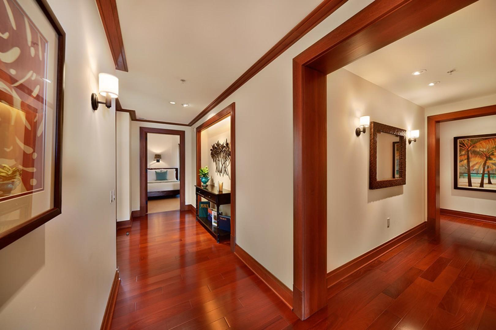 Sea Mist Villa 2403 - Entry Area and Hallways with Richly Colored Hardwood Floors Both Lead to the Front Door and Bedrooms