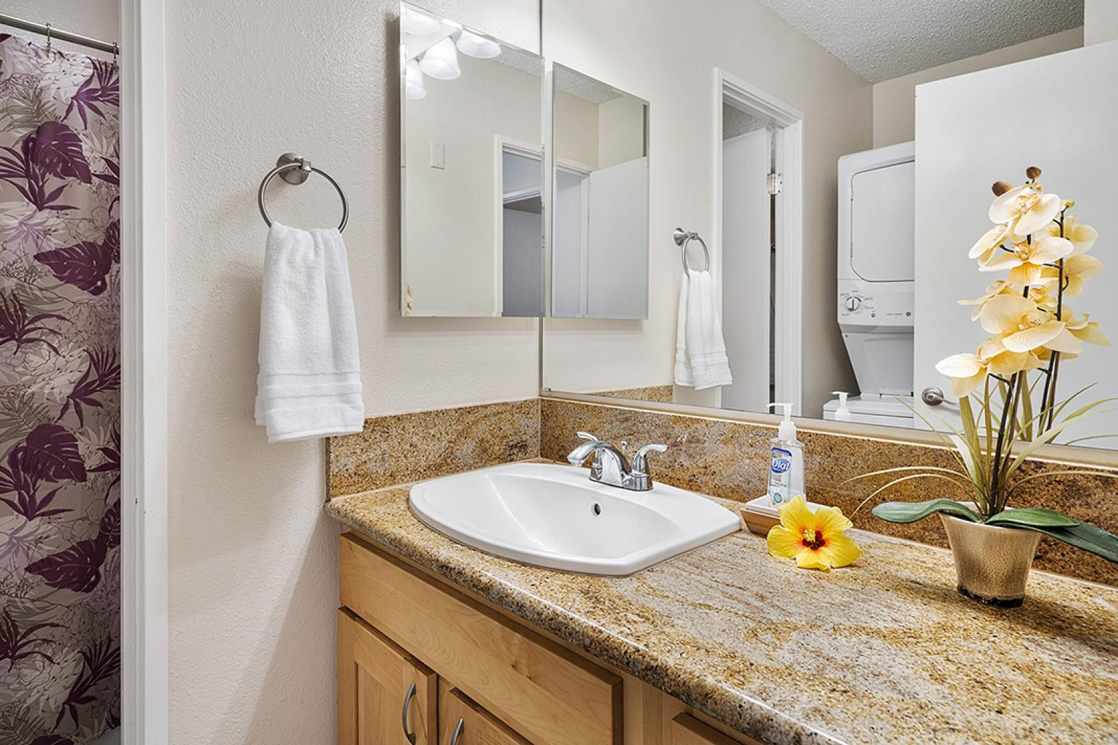 Guest bathroom with full sized Washer & Dryer