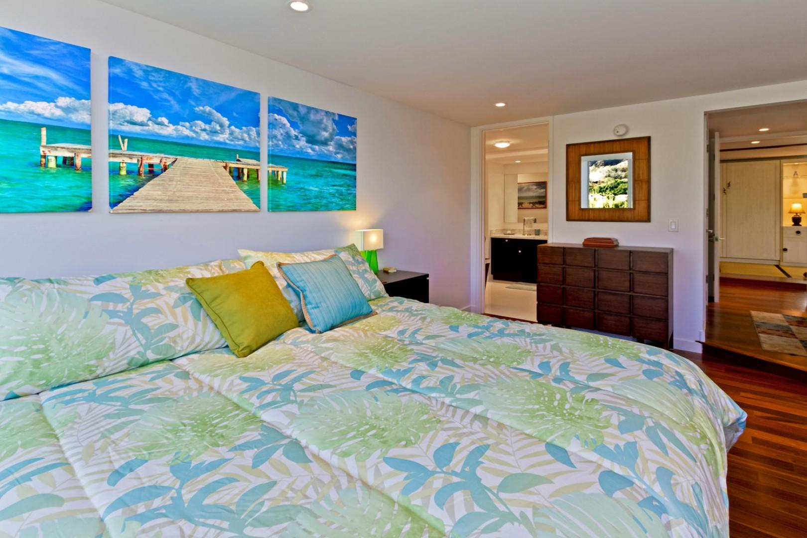 Master bedroom with a king-size bed. Television in room is not pictured.