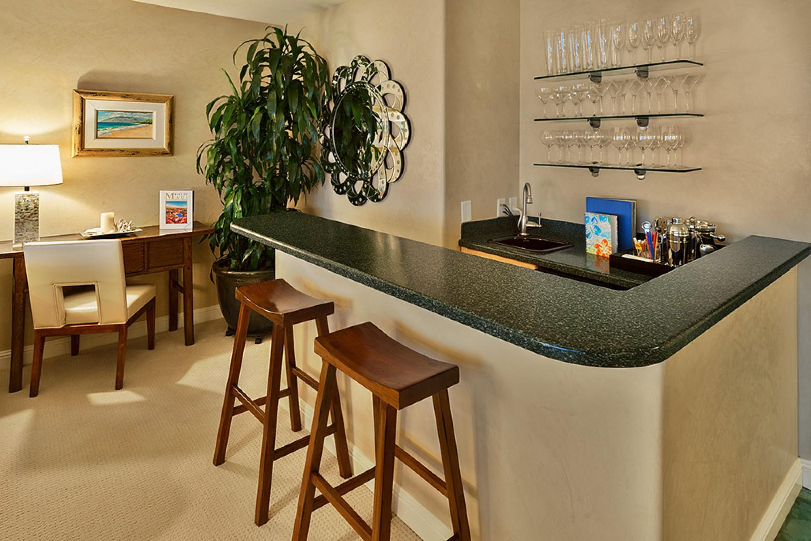 Convenient Wet-Bar with Writing Desk, Icemaker, Wine Fridge and a Full Bar Set Up