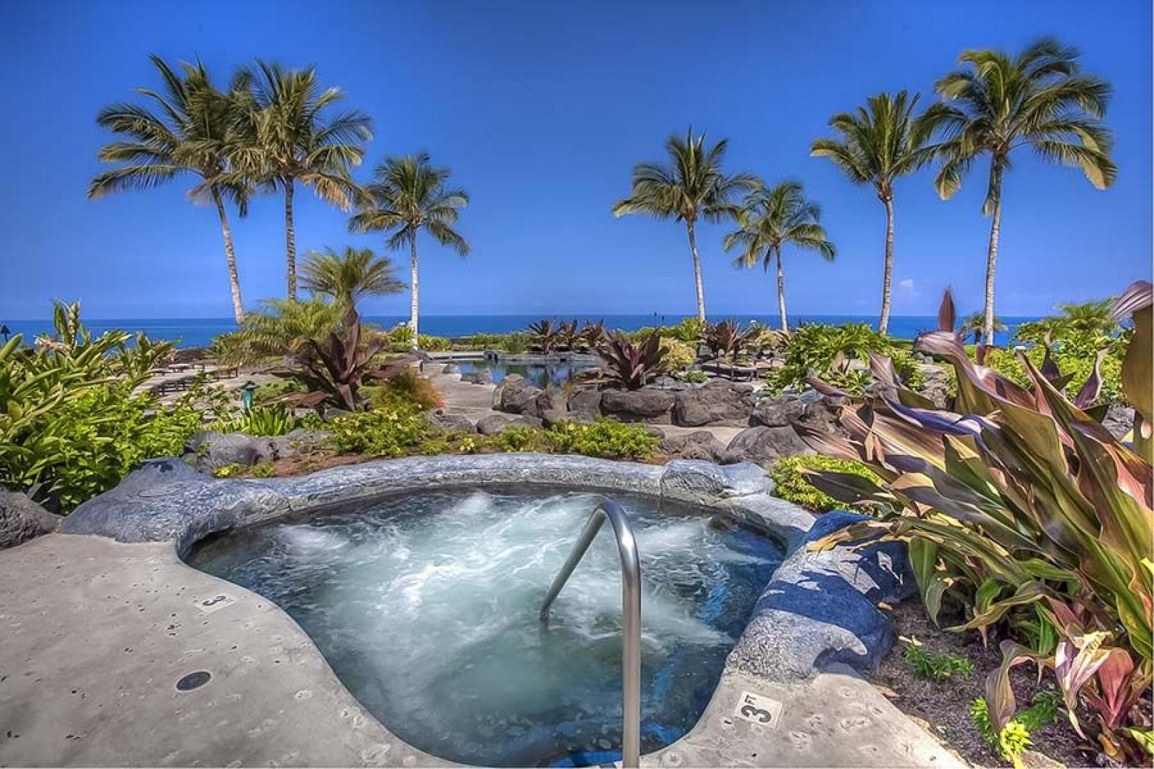 Soak in the oceanfront jacuzzi while sipping on a Mai Tai