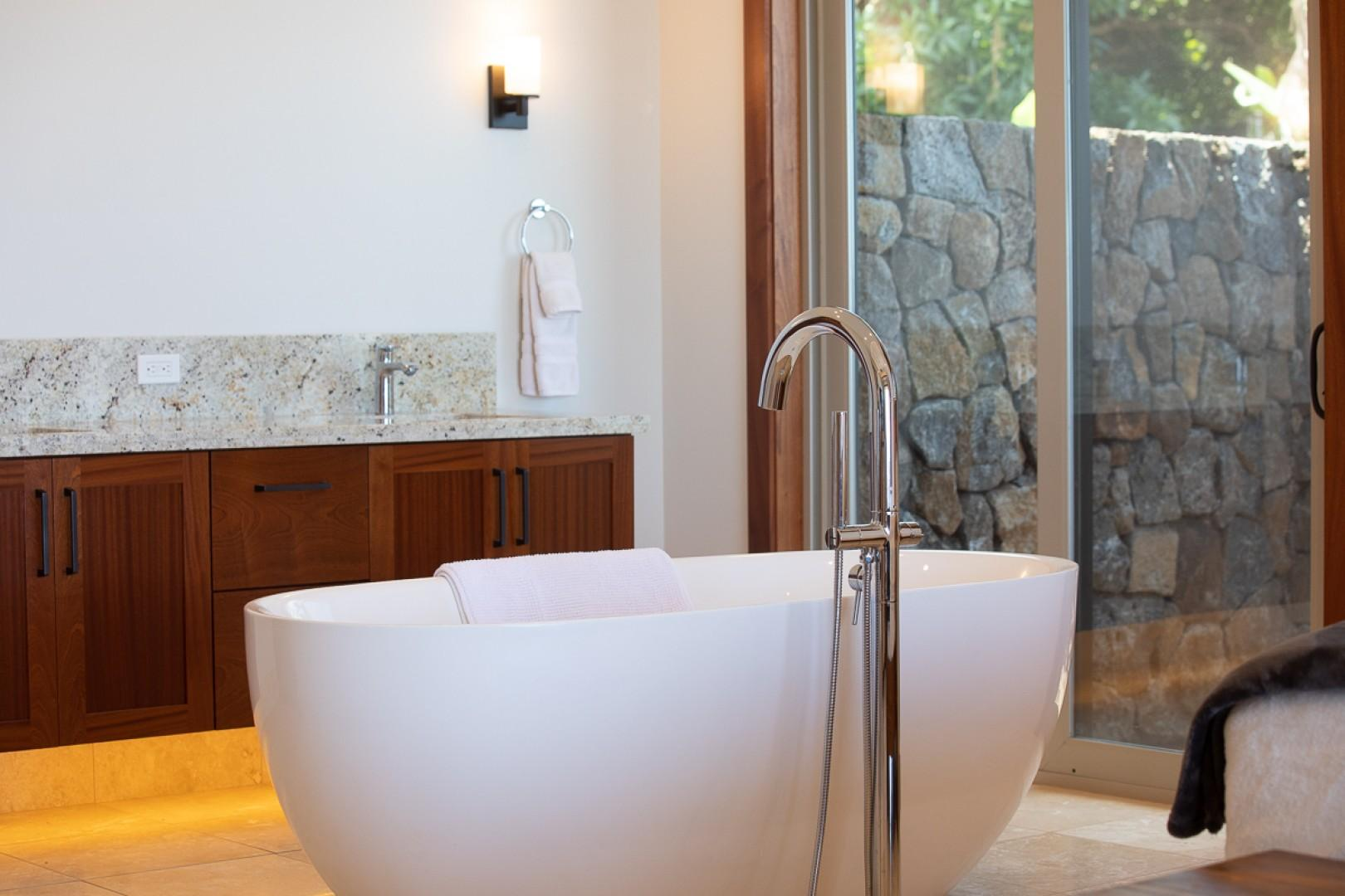 Soaking tub and a private outdoor shower with ocean view!