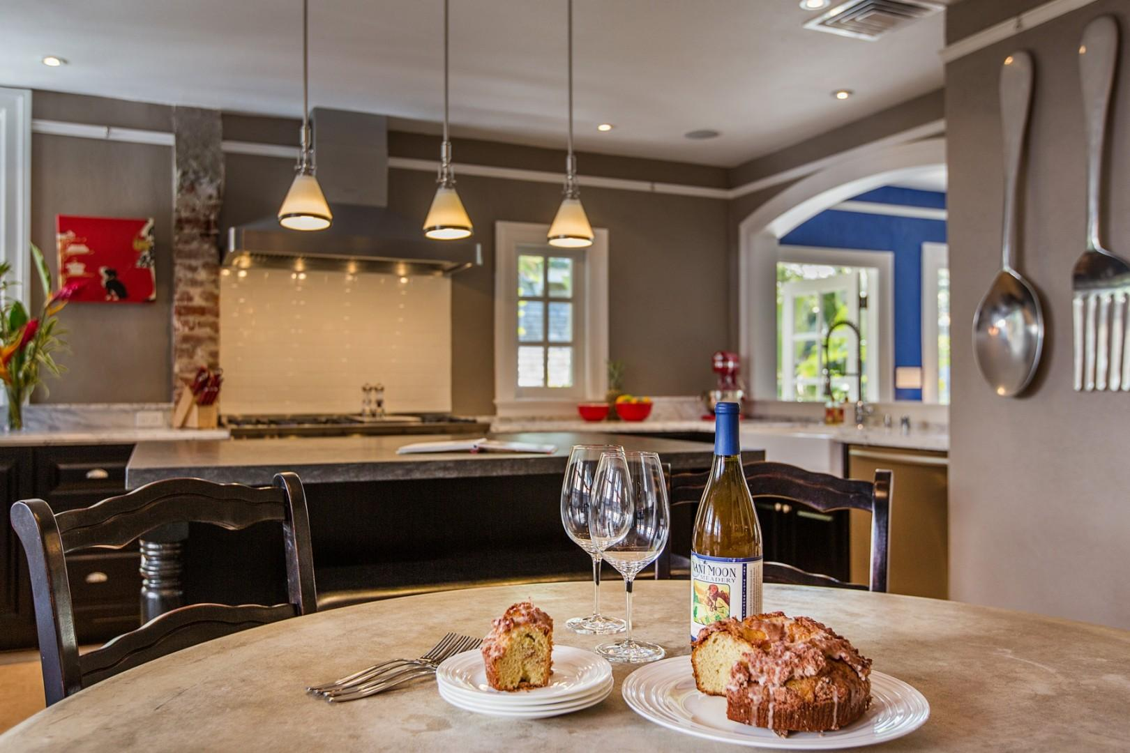 Dining room and kitchen. This chef's dream kitchen includes top-of-the-line appliances and extra amenities like a KitchenAid mixer.