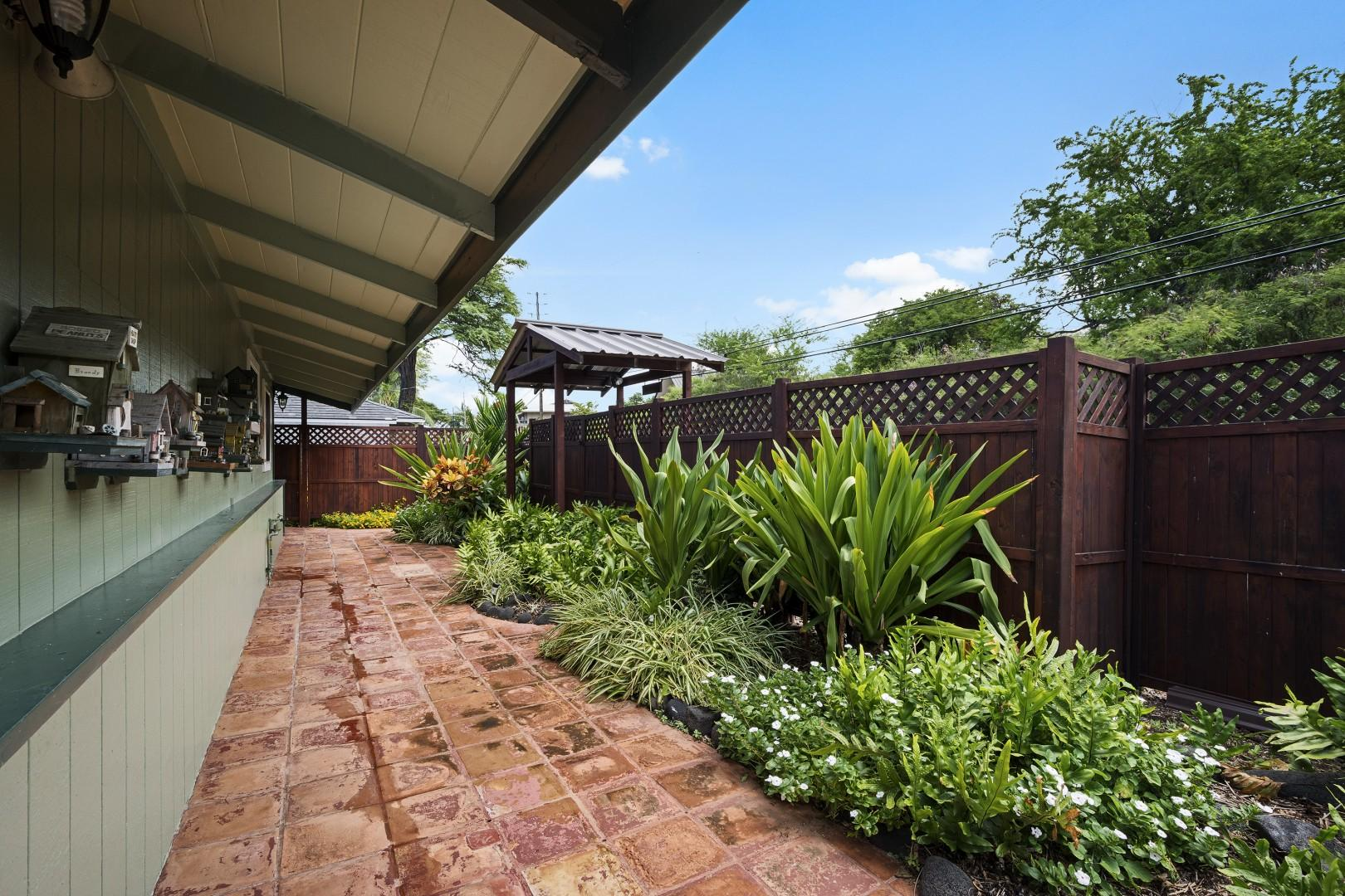 Front entry, politely landscaped with tropical plants
