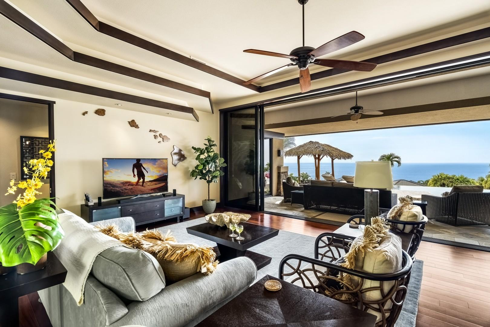Tropically appointed living room with Queen sleeper sofa