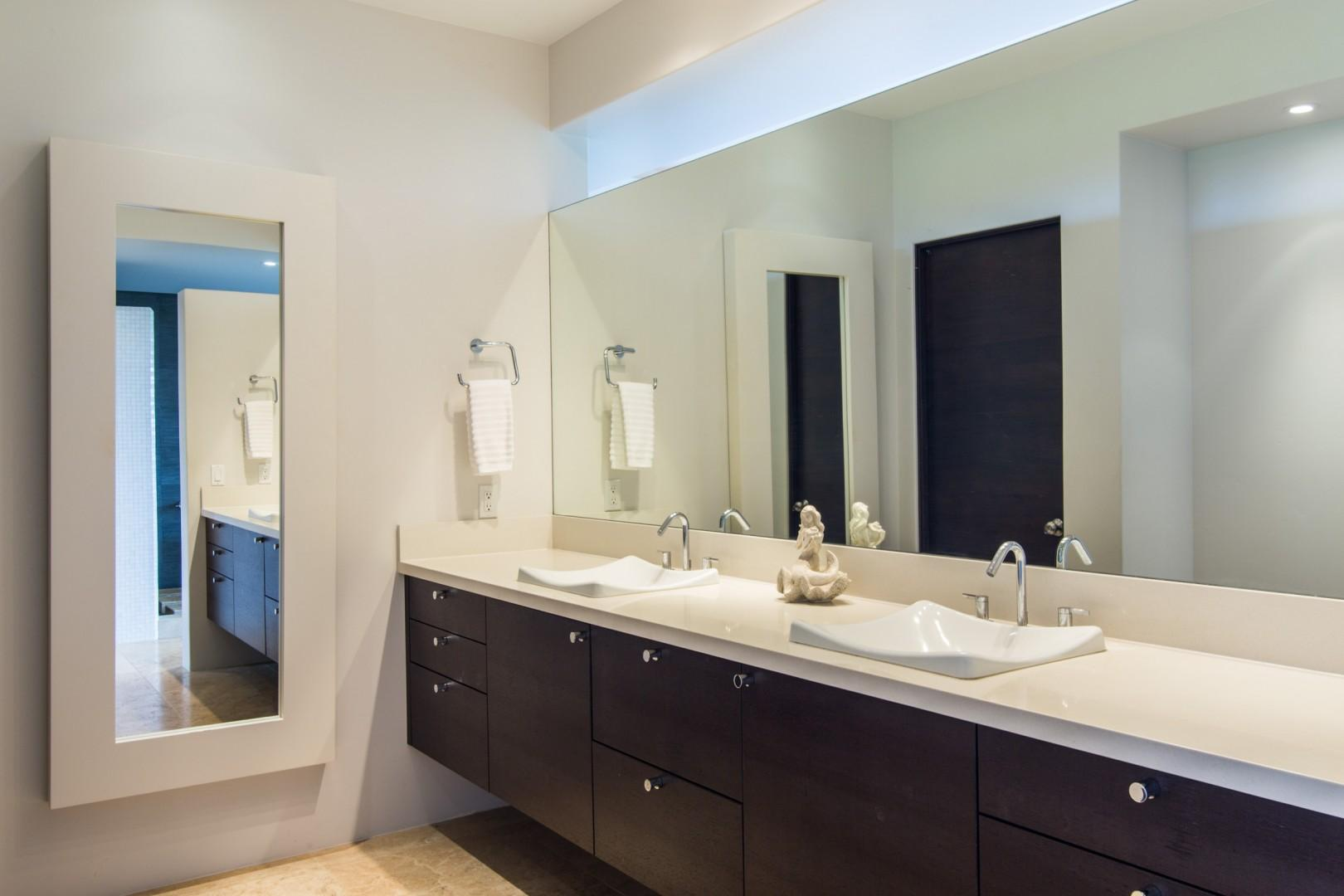 Master bath features double sinks and a large walk-in closet on the left.