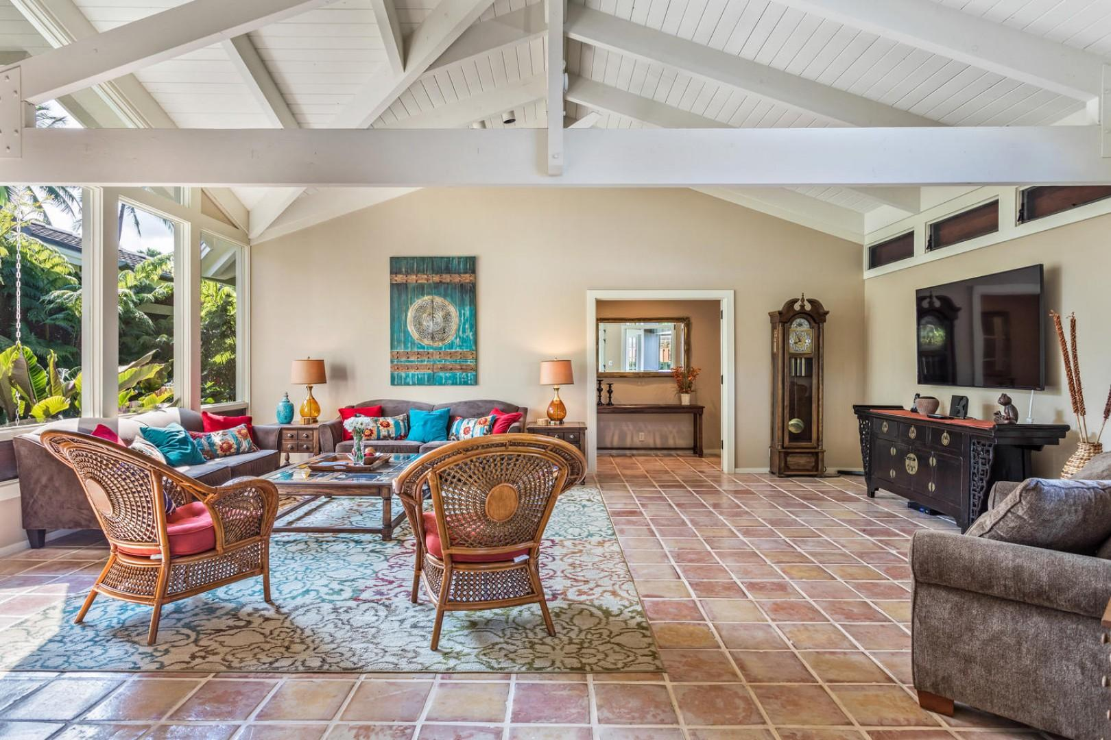 The expansive living room has ample comfortable seating.