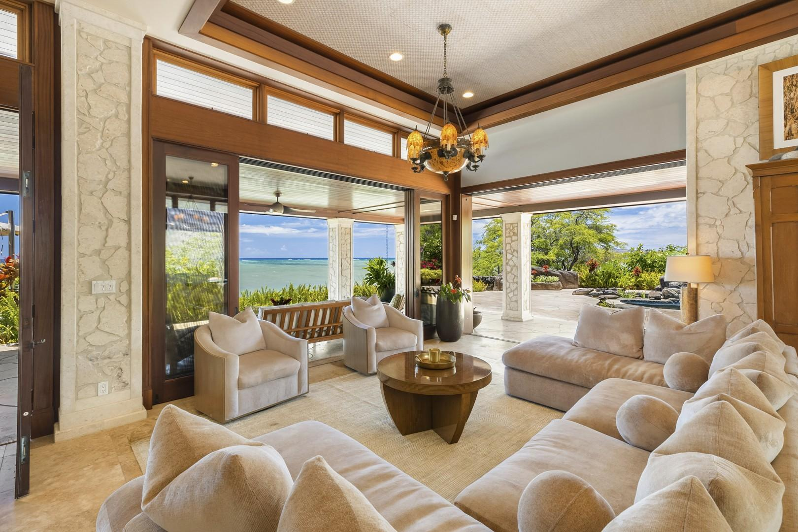 Living Room has sliding doors that pocket back and open up to the Poolside and Oceanside Lanais