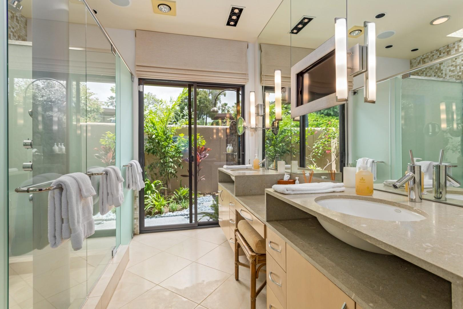 Master Bath w/Dual Vanity, Flatscreen TV, Privacy Commode, Walk-In Shower & Sliding Doors to Outdoor Shower Garden.