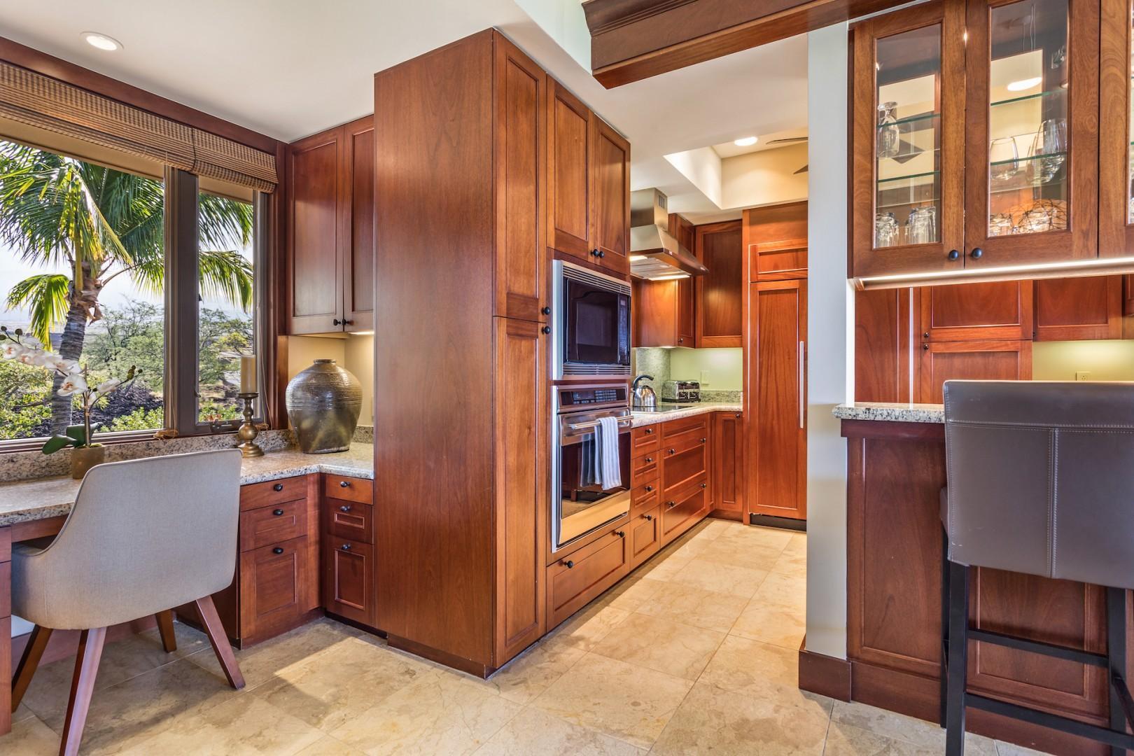 Built-in desk and bar seating frame the kitchen entrance.