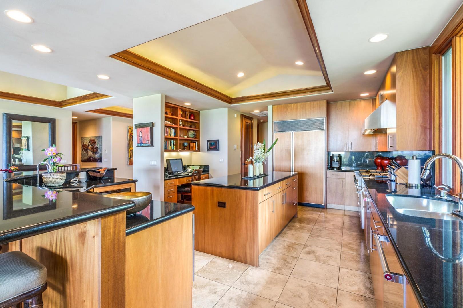 The gorgeous kitchen offers a bonus built-in desk area.