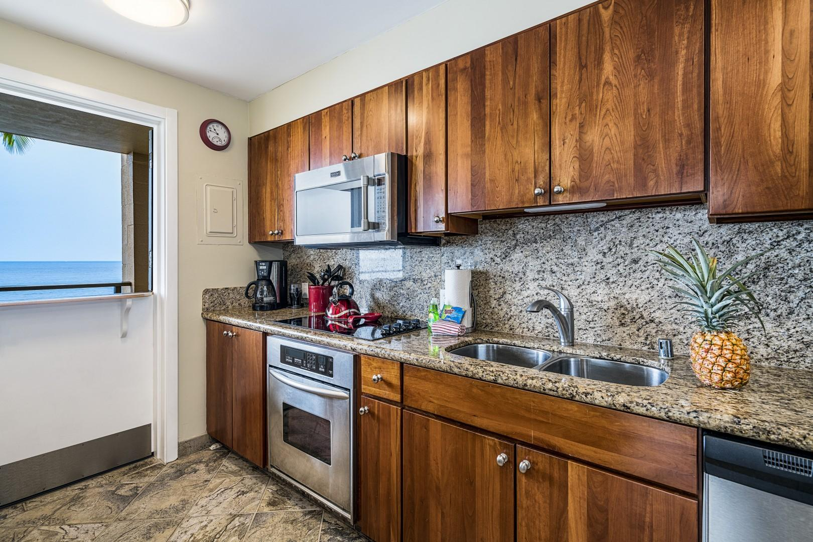 Granite counters and stainless appliances in the gourmet kitchen!