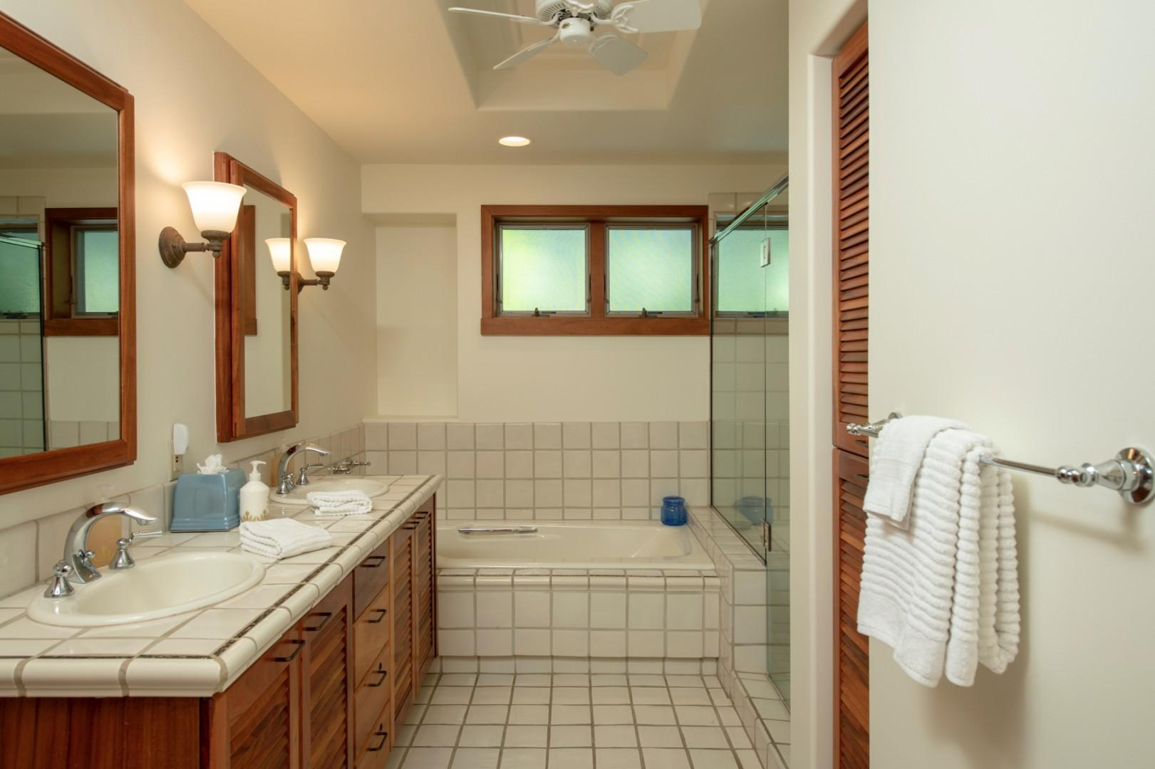 Second bathroom w/dual vanity, soaking tub & walk-in shower.