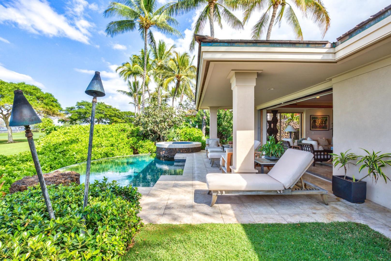 Pool deck w/ocean-view infinity pool, private spa & tiki torches.