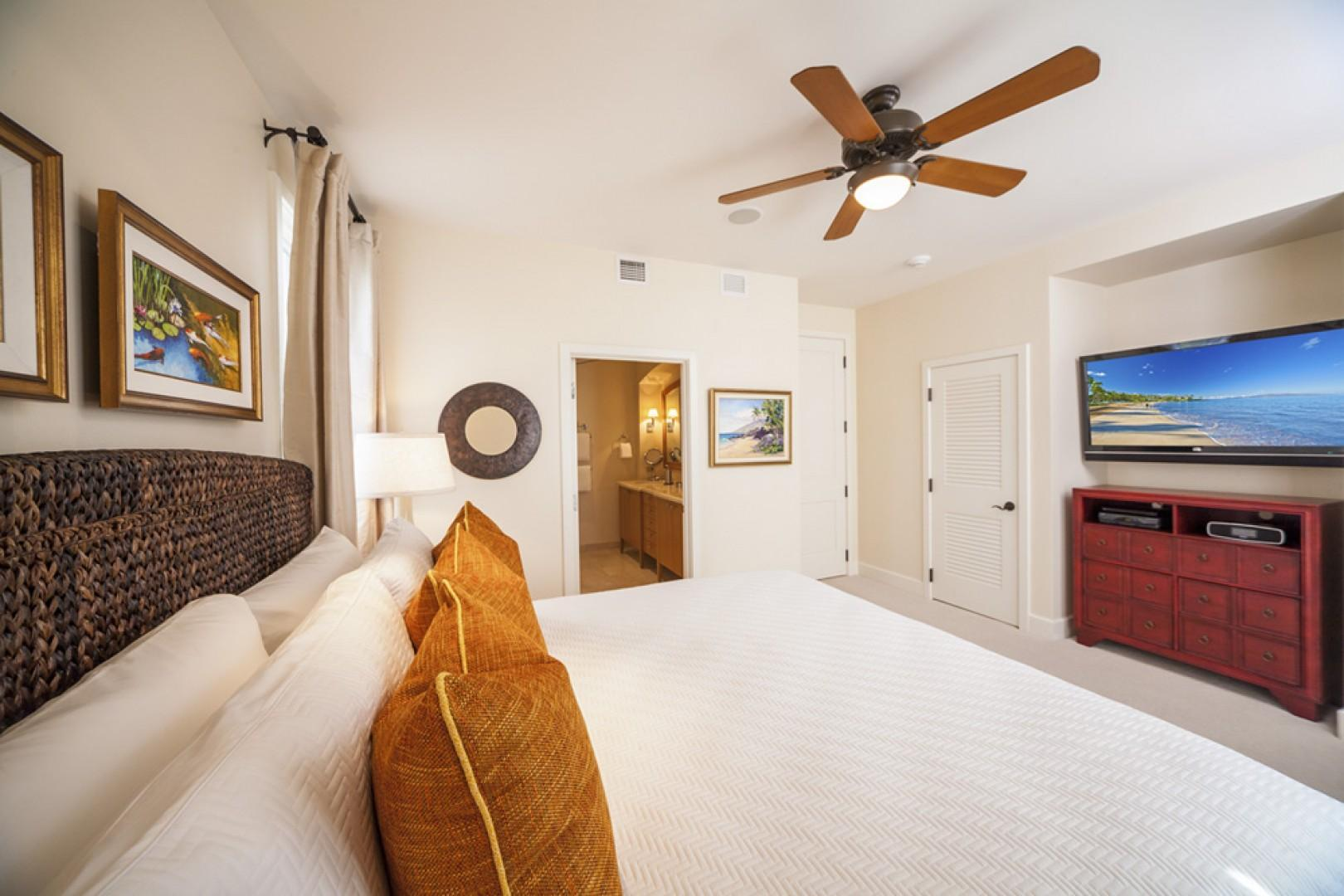 Second master bedroom, with king-size bed and large TV.