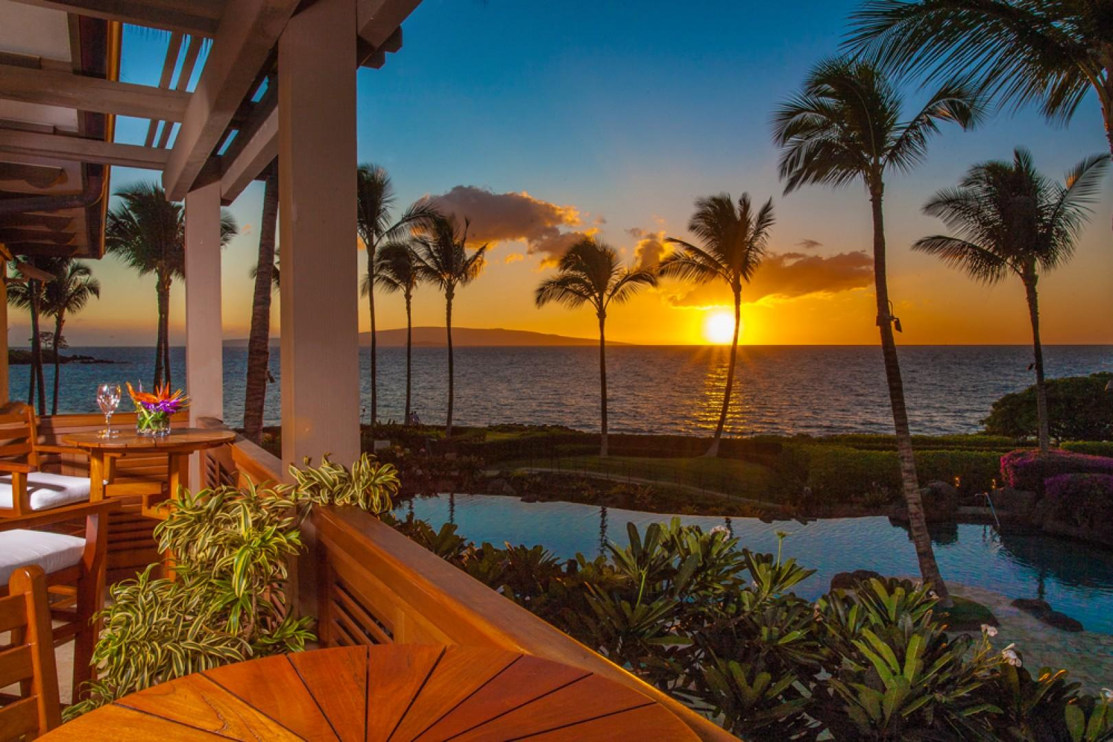 A Pacific Ocean Sunset View Looking Directly Over The Adult Pool and Hot Tub From the Private Veranda Off the A201 Royal Ilima Master Bath