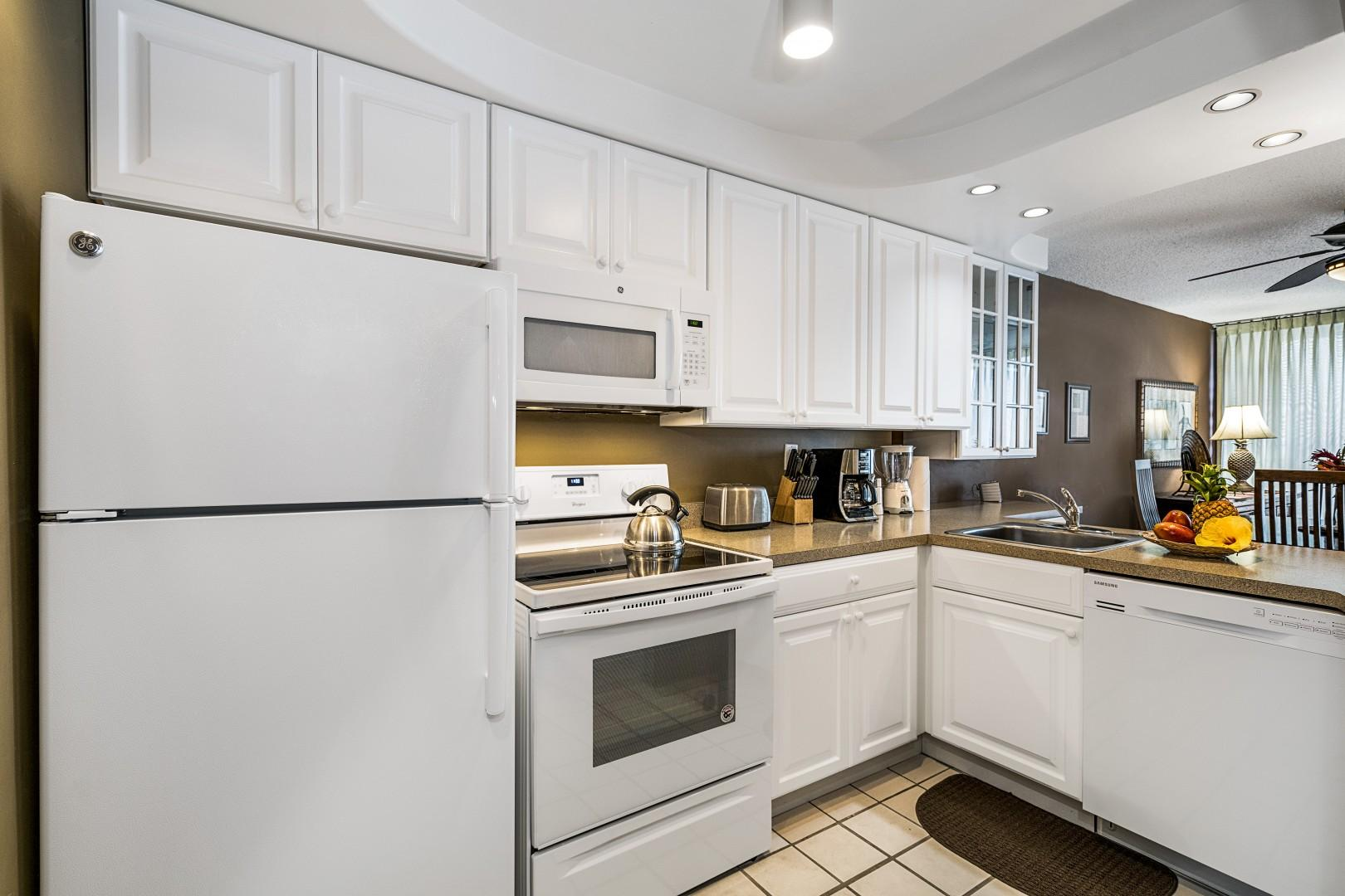 Fully equipped kitchen steps from outdoor dining!