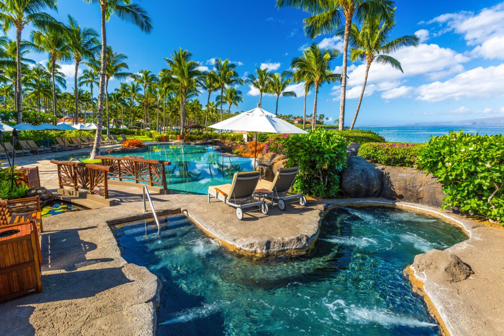 Sun-soaked oceanview adult-use hot tub.