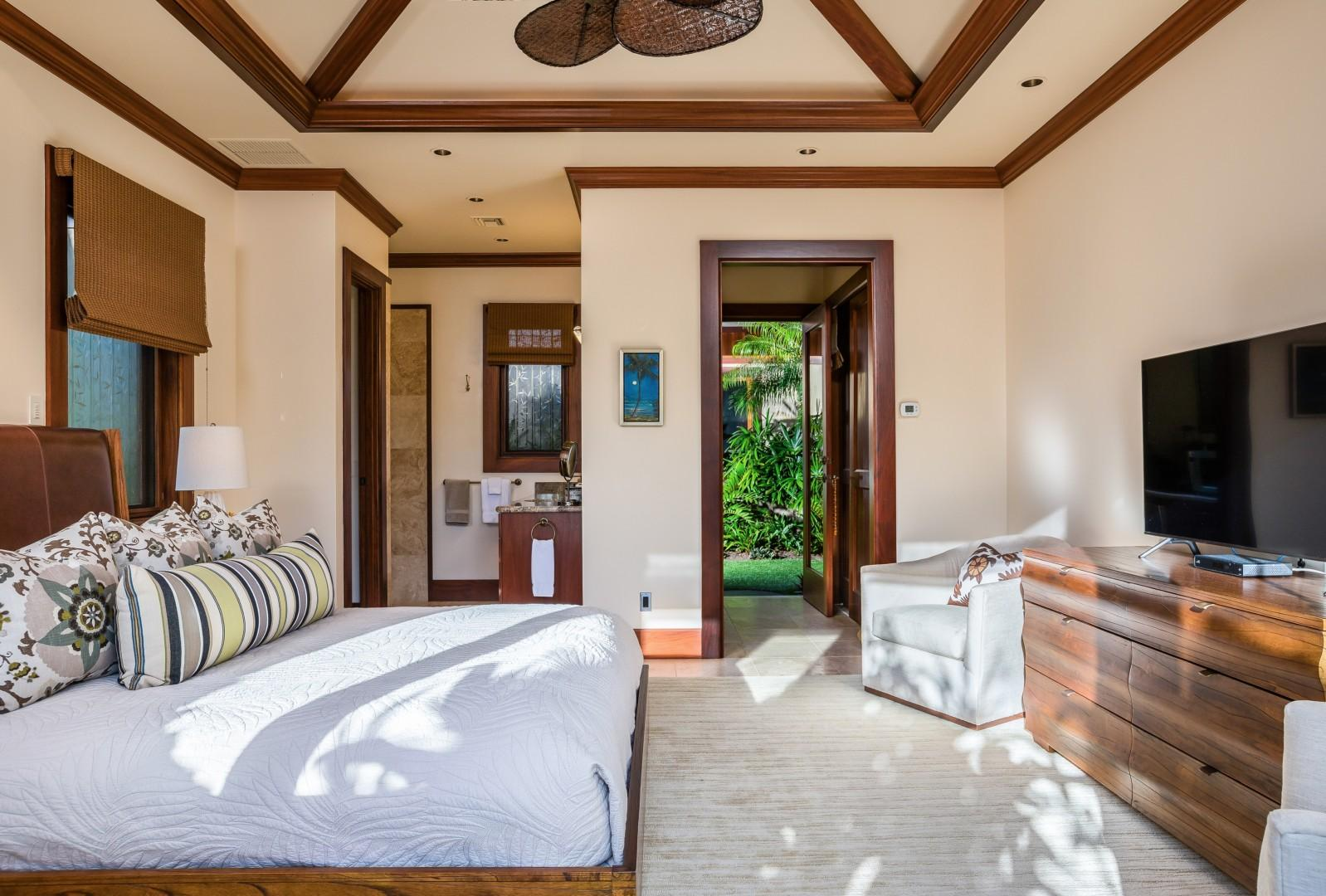 Fourth bedroom suite with vaulted ceilings. View toward private kitchenette and private entrance.