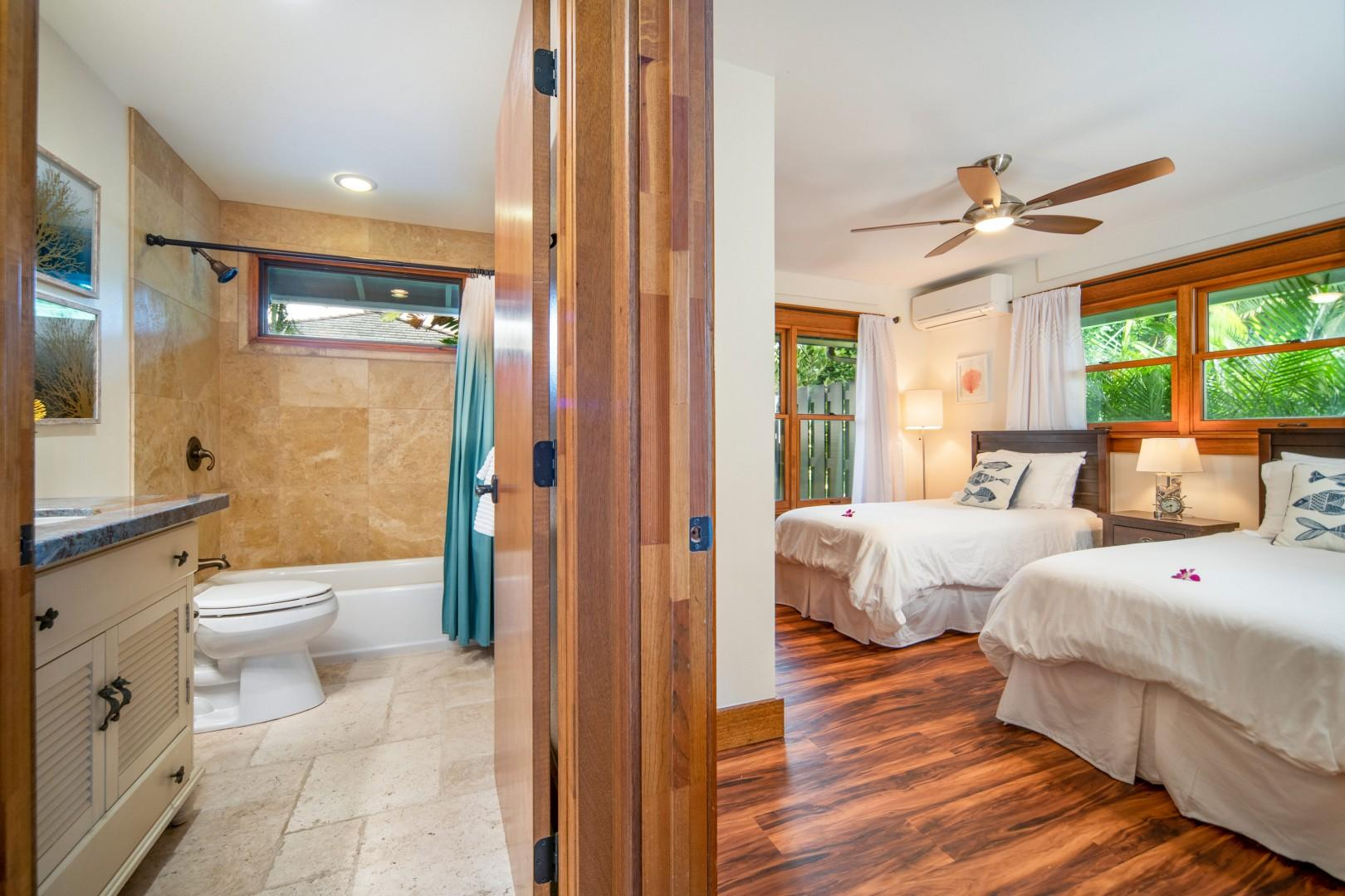 A view from the living room into the twin bedroom and hallway bathroom.