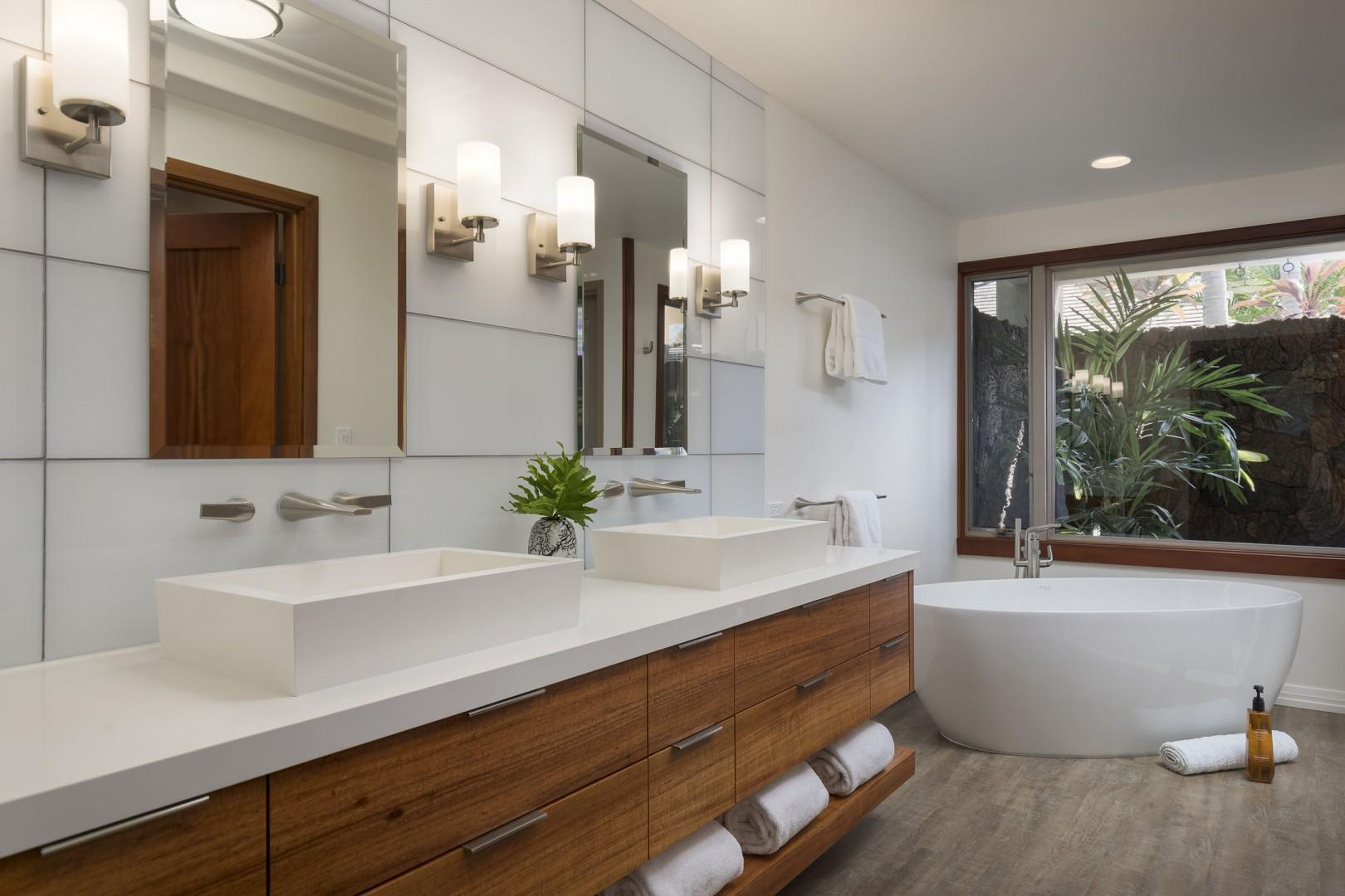 A Master Bath that rivals any 5 star hotel and includes a soaking tub, walk in shower and outdoor shower