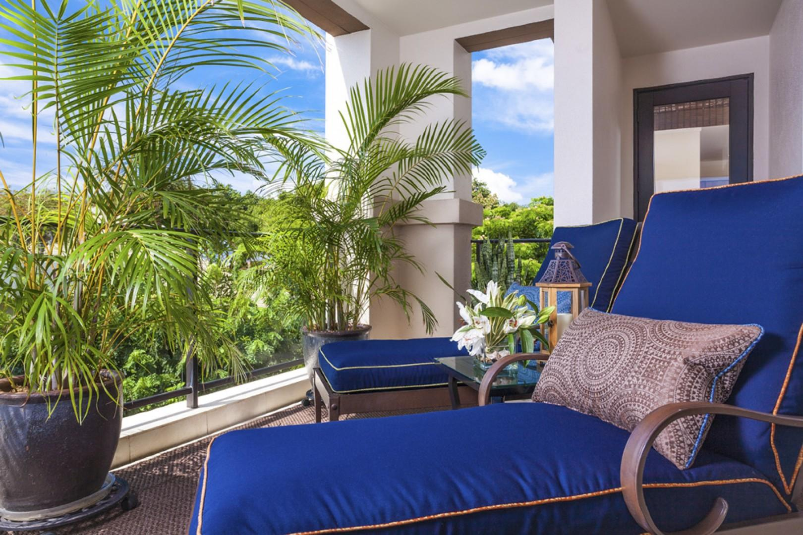 Alternate view of the wrap-around lanai, with room-for-two plush chaise lounge chairs and ocean views.