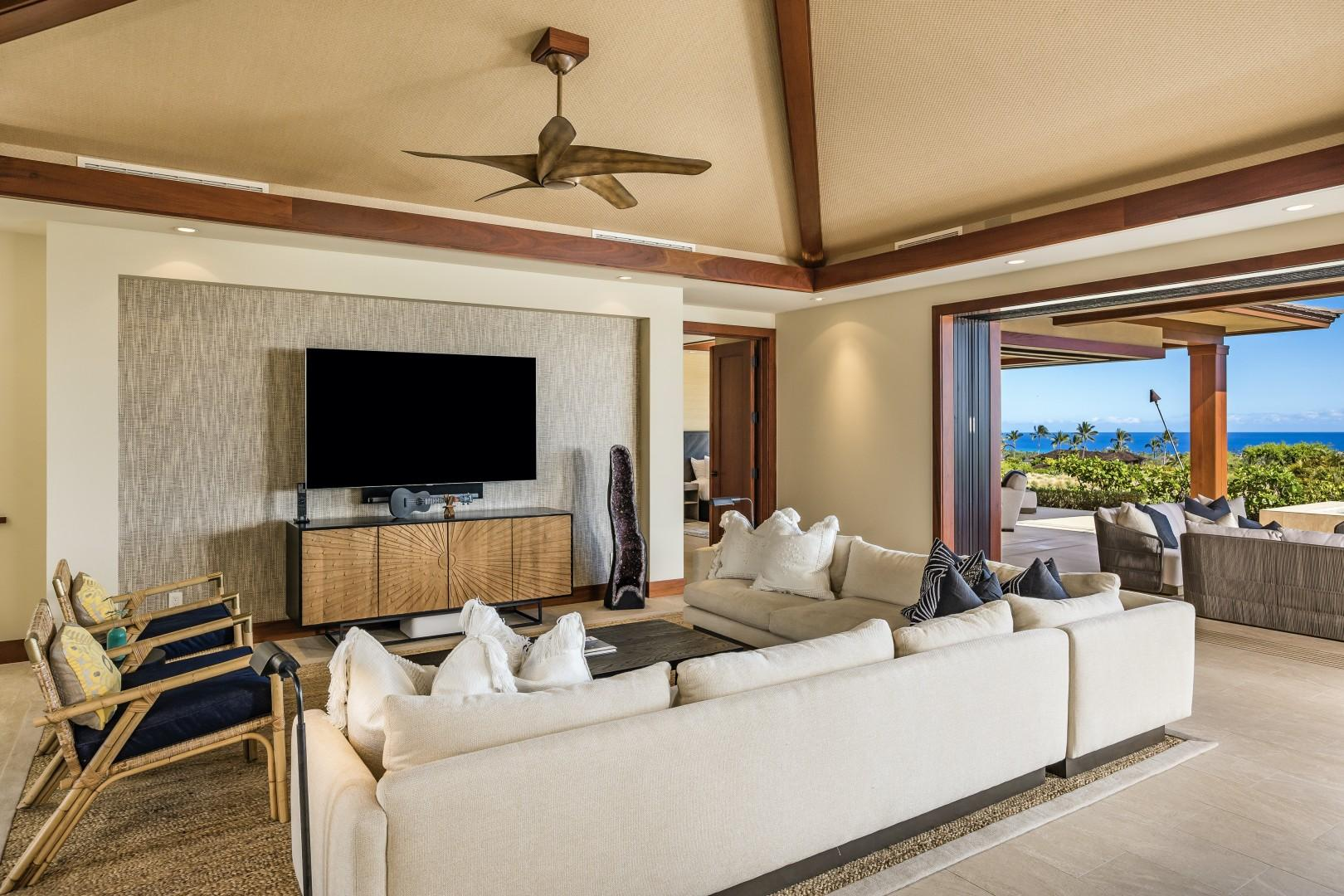 """The living area's wraparound plush seating, inset entertainment wall with 75"""" smart flat screen TV and Sonos audio system provide entertainment perfection."""