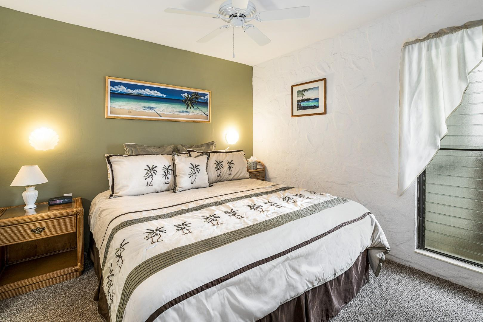 Master bedroom featuring King sized bed!