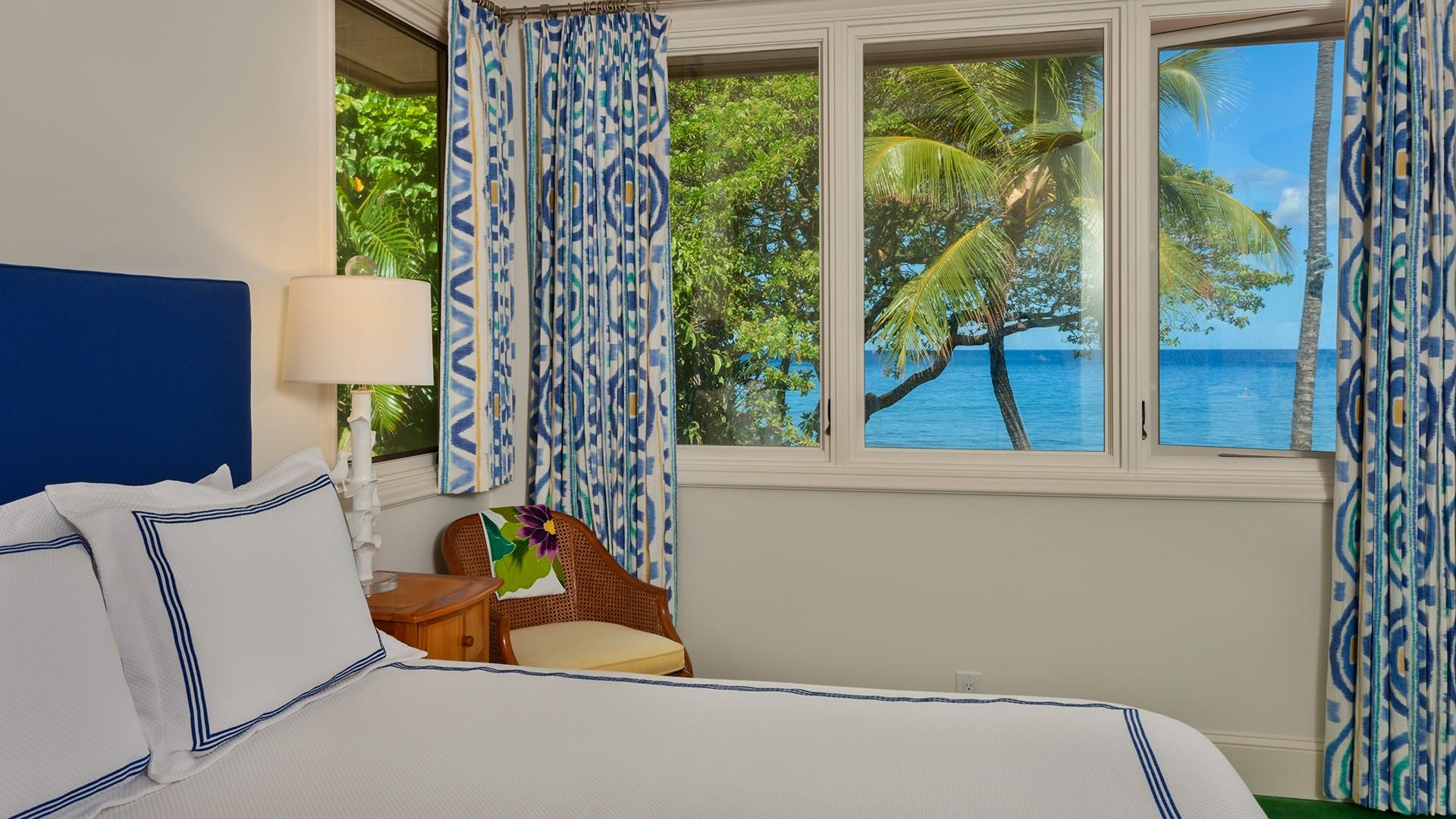 Wake up to a spectacular ocean view in the third bedroom, which is equipped with a queen-size bed and flat-screen television.