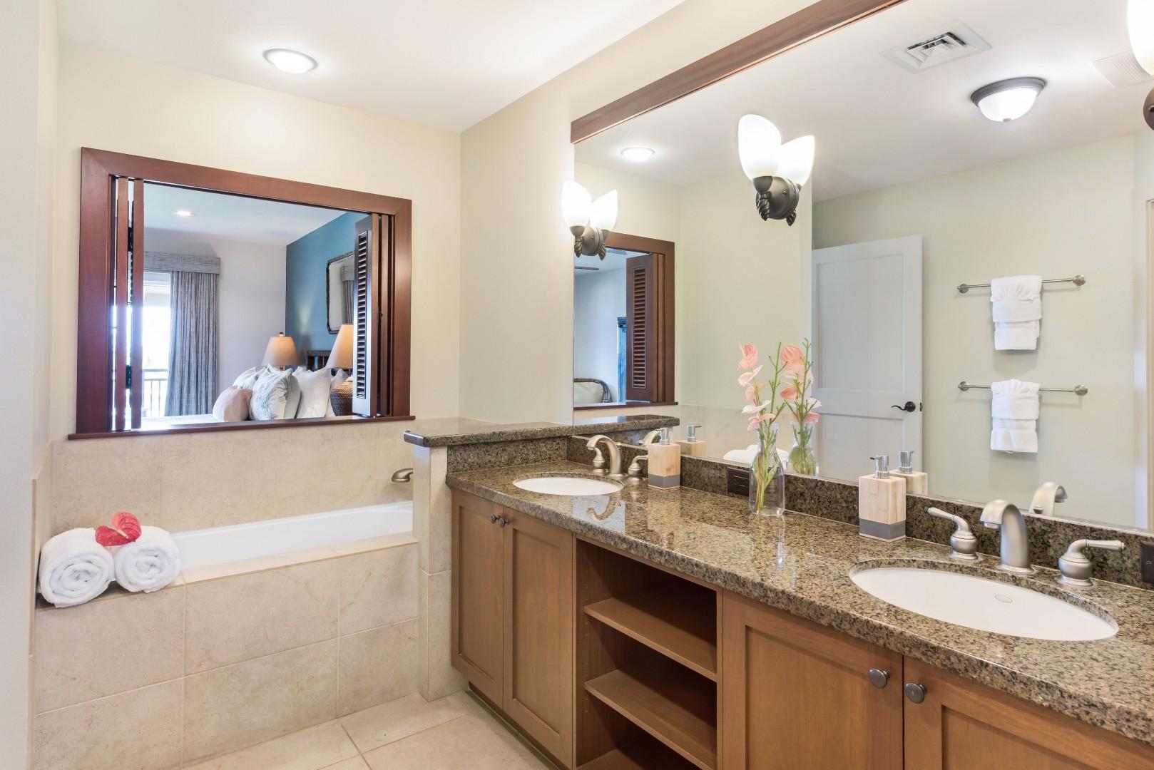 Master bath w/ dual sinks, soaking tub, ensuite to master bedroom