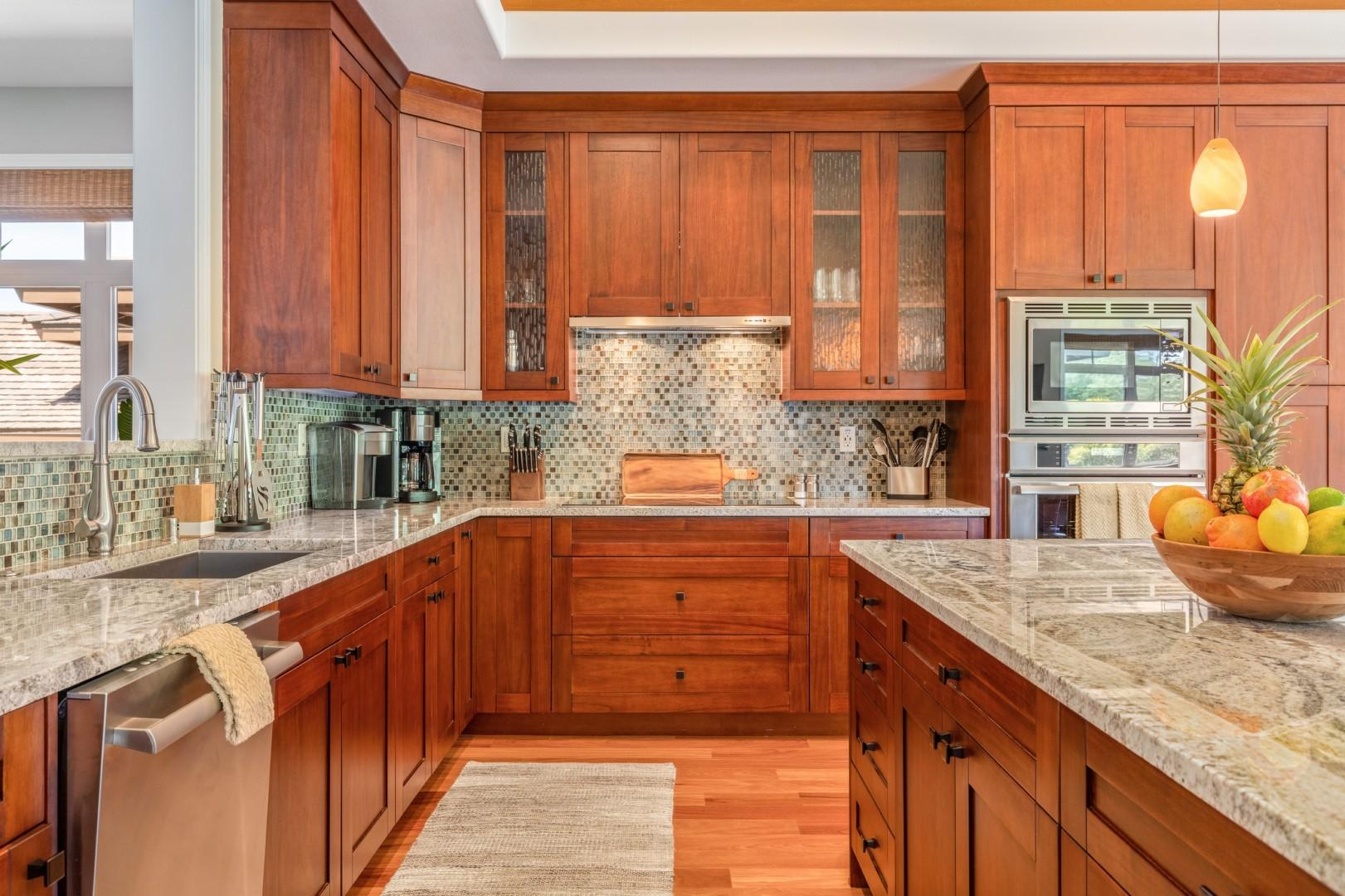 Spacious modern kitchen with large granite island/breakfast bar, granite countertops and elegant finishes.