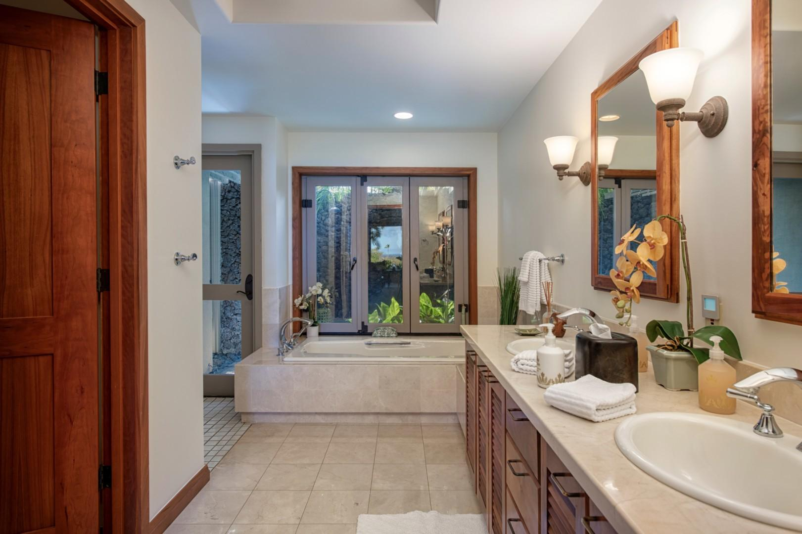 Deluxe master bath w/oversized soaking tub, separate walk-in shower & tropical outdoor shower.