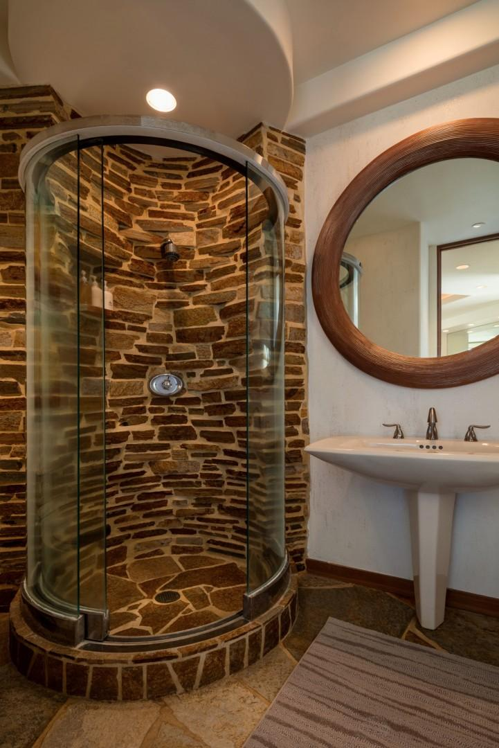 Second bath with unique circular shower.