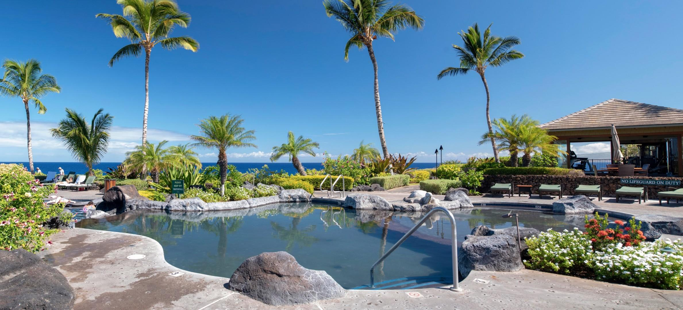 Hali'i Kai Resort's private swimming pool w/ multi levels and depths (fitness center in background)