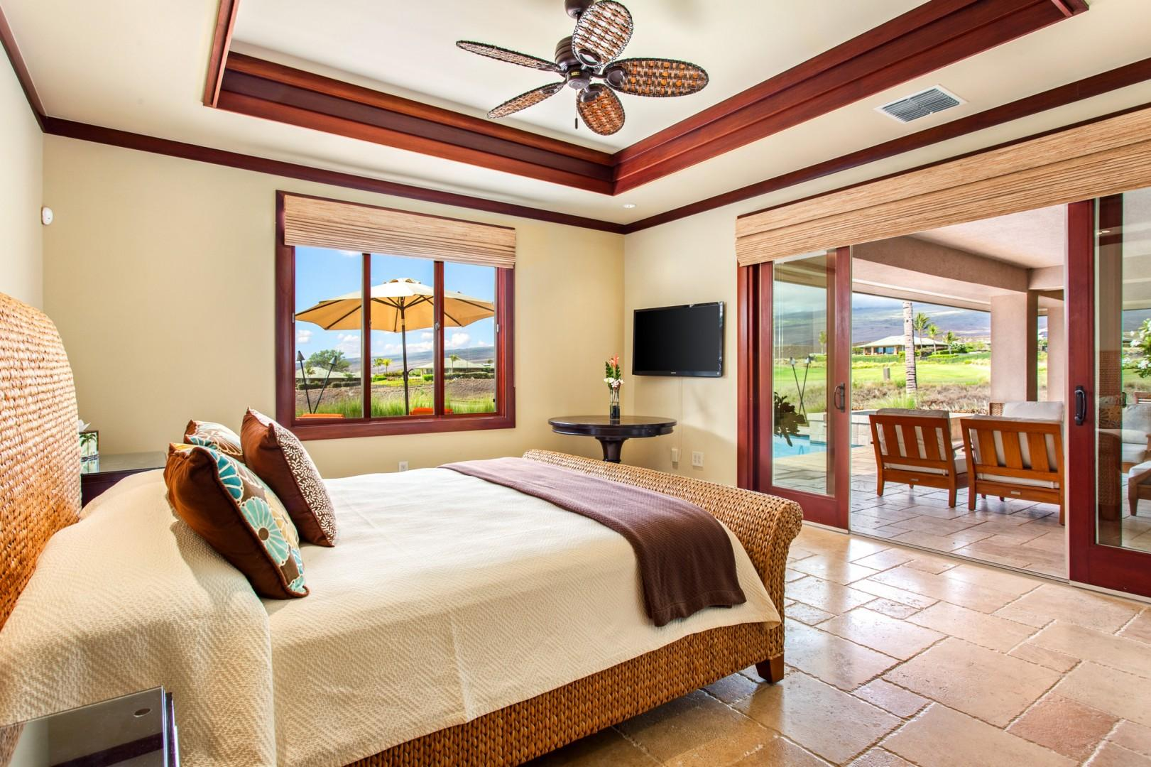 Master bedroom suite #1 offers a king bed, lanai access, and en-suite bath.