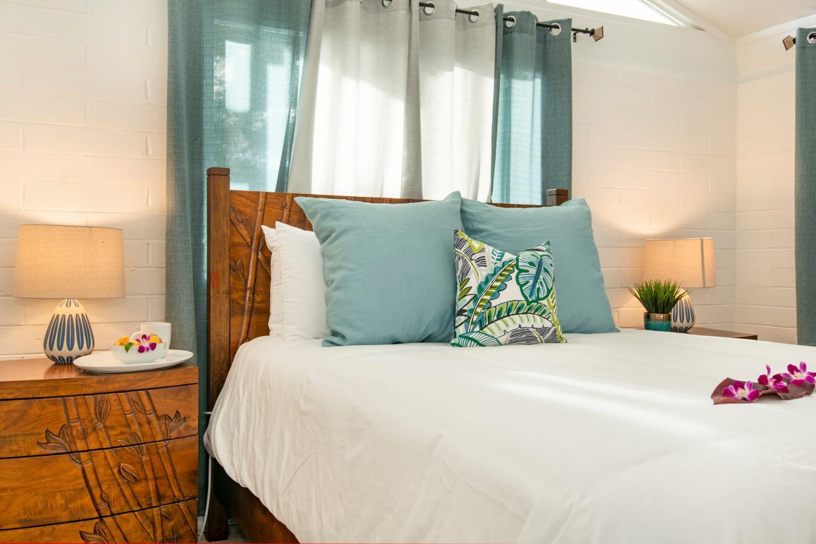 Bedroom 3 - Queen bed, split ac with front yard and garden views.