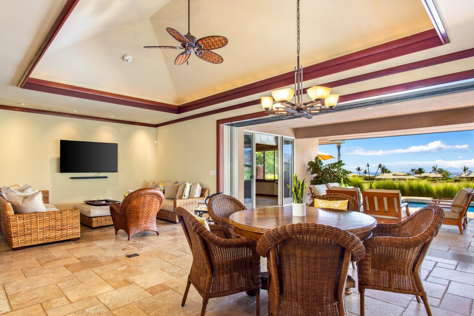 Great room transitions seamlessly onto the spacious lanai with ample lounge seating and excellent views.