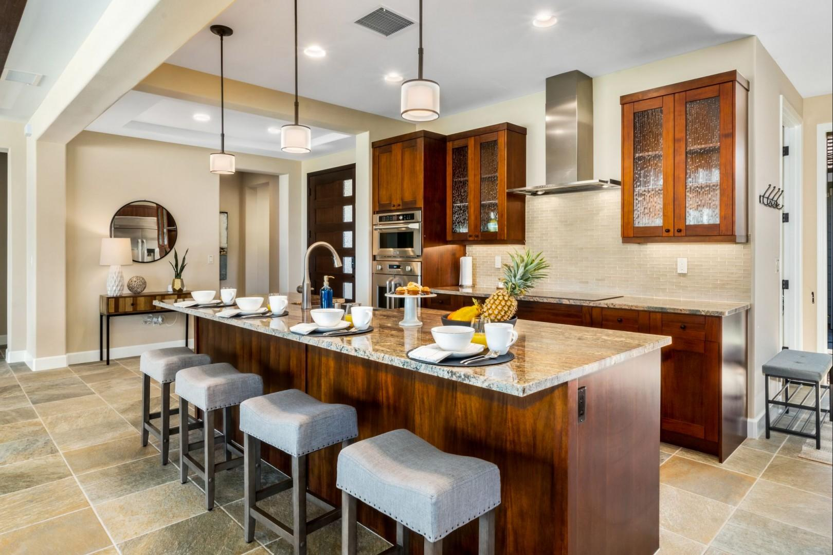 Enjoy breakfast and the expansive kitchen island